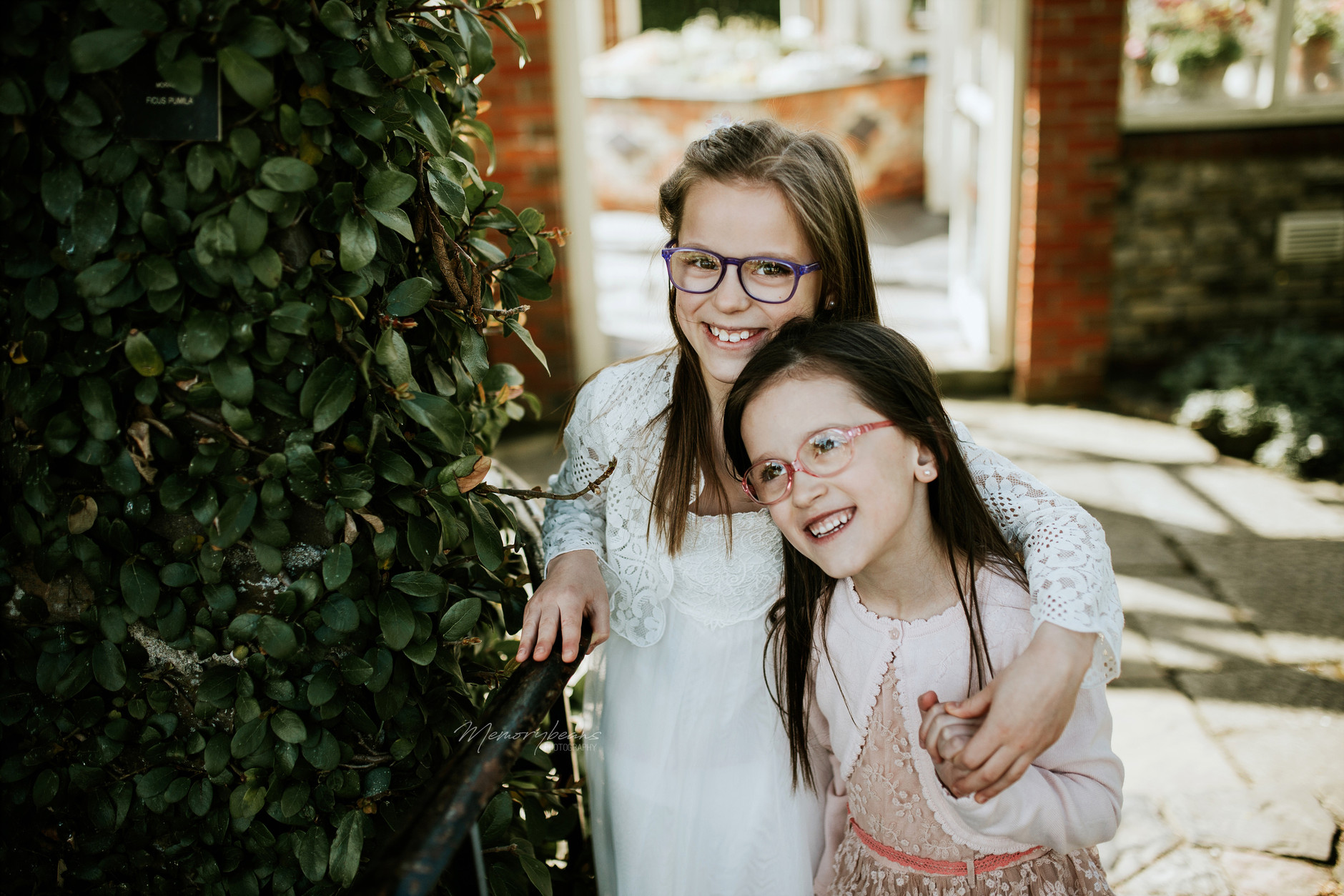 Two sisters posing for the camera after first holy communion