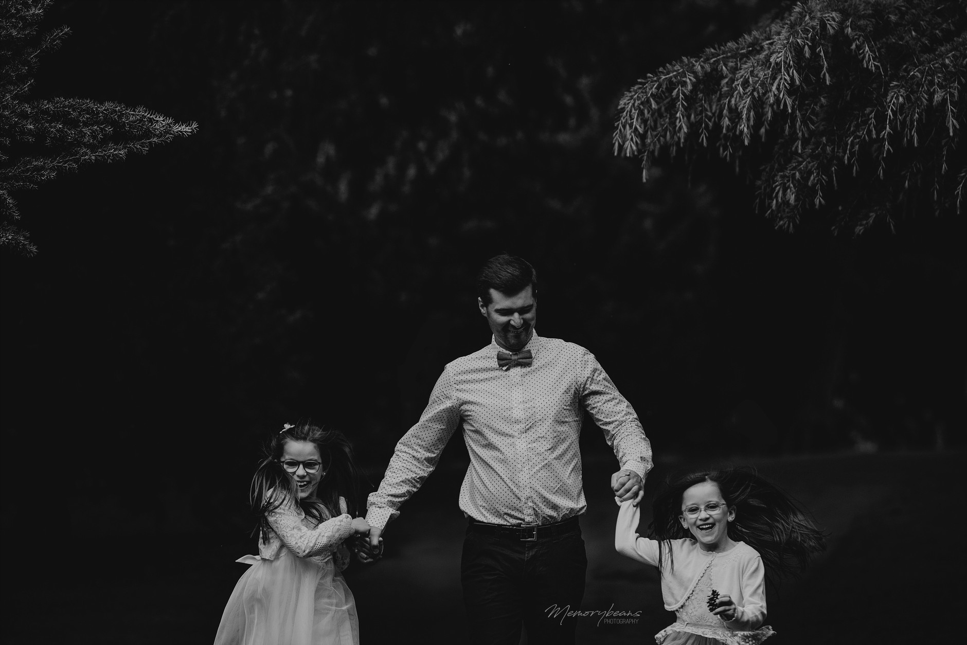 Father running with his two daughters on first holy communion: fun