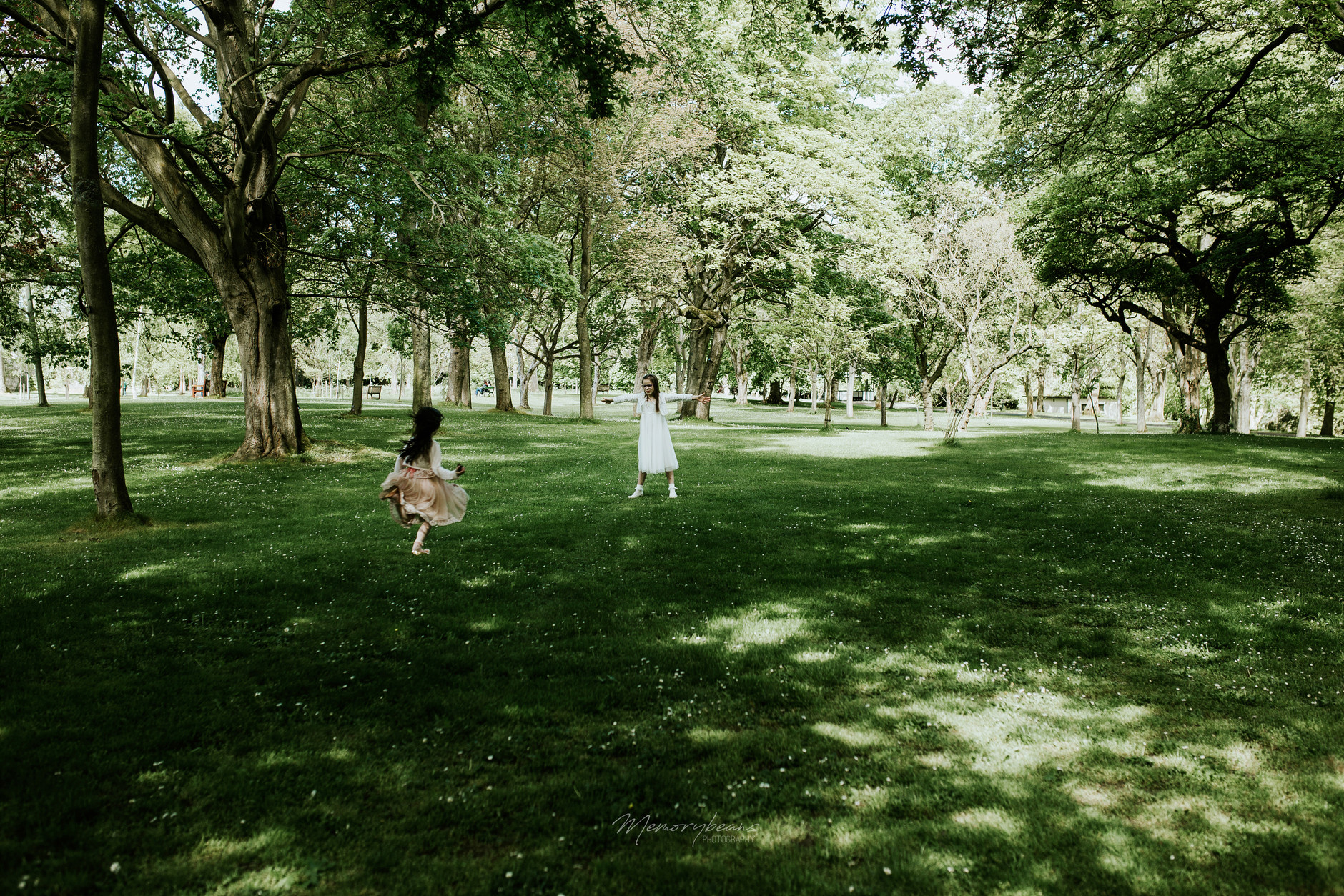 Sisters running and having fun after first holy communion ceremony