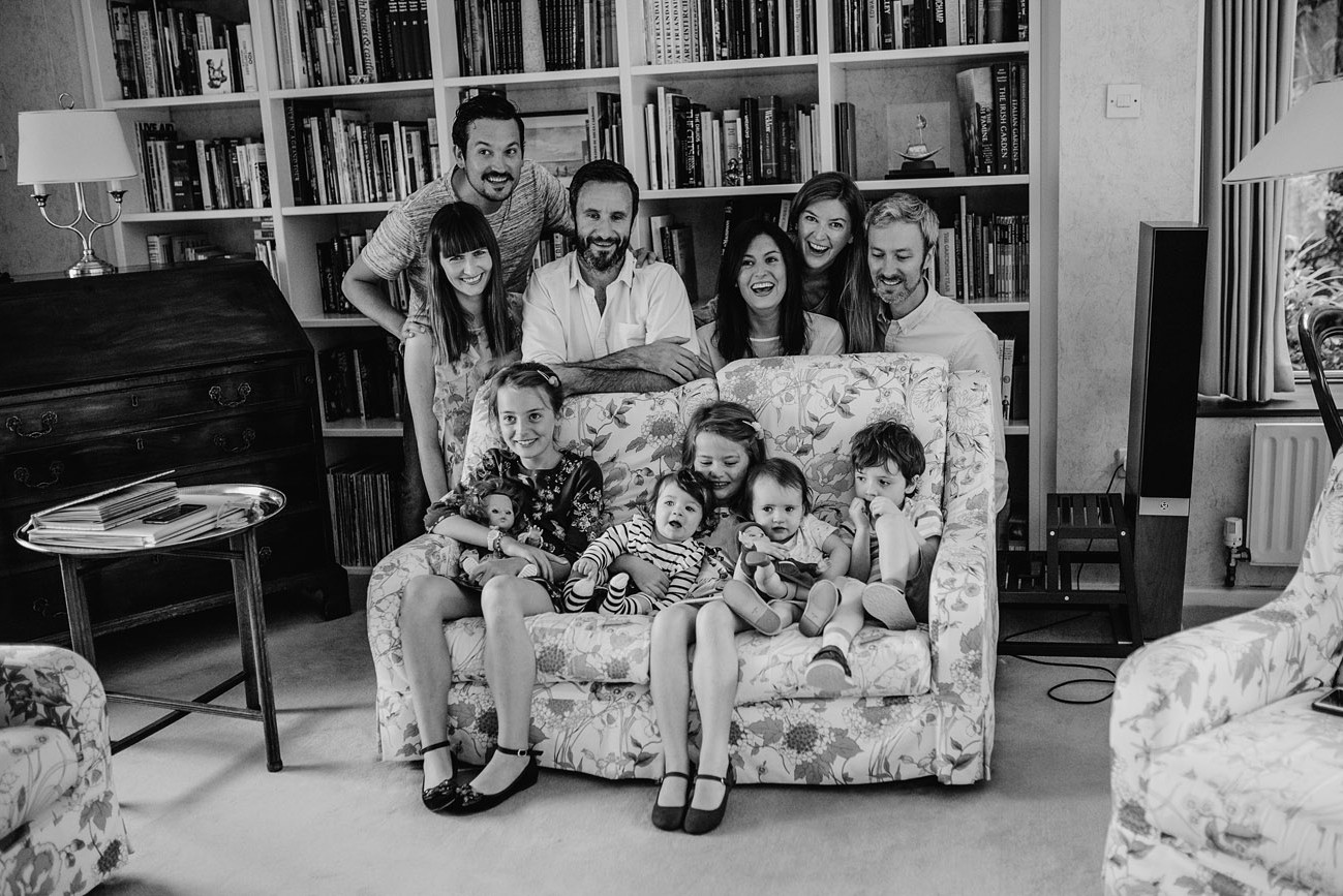 Large group family portrait at home of parents and children on the couch