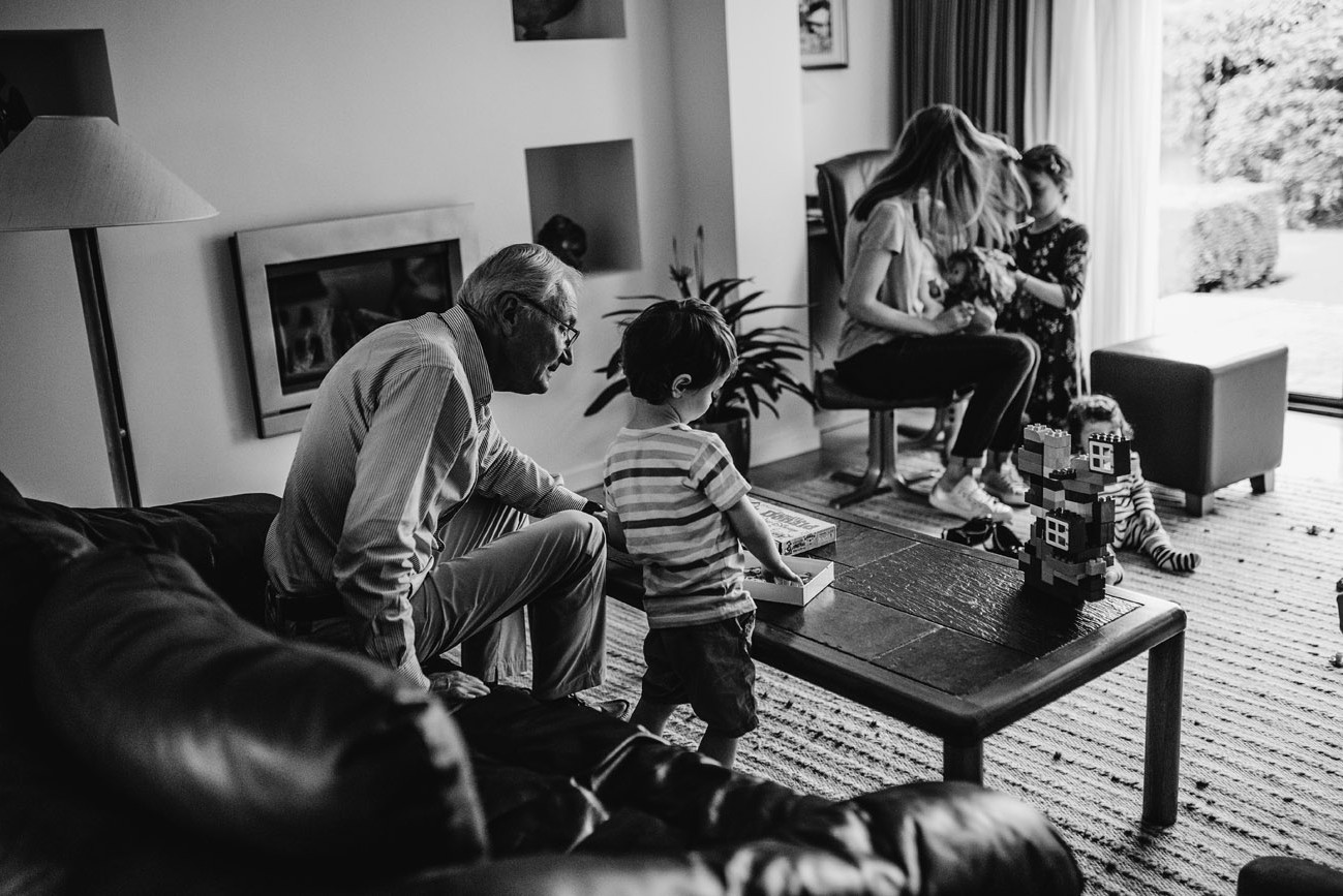 Wide photograph of grandchildren playing in the house