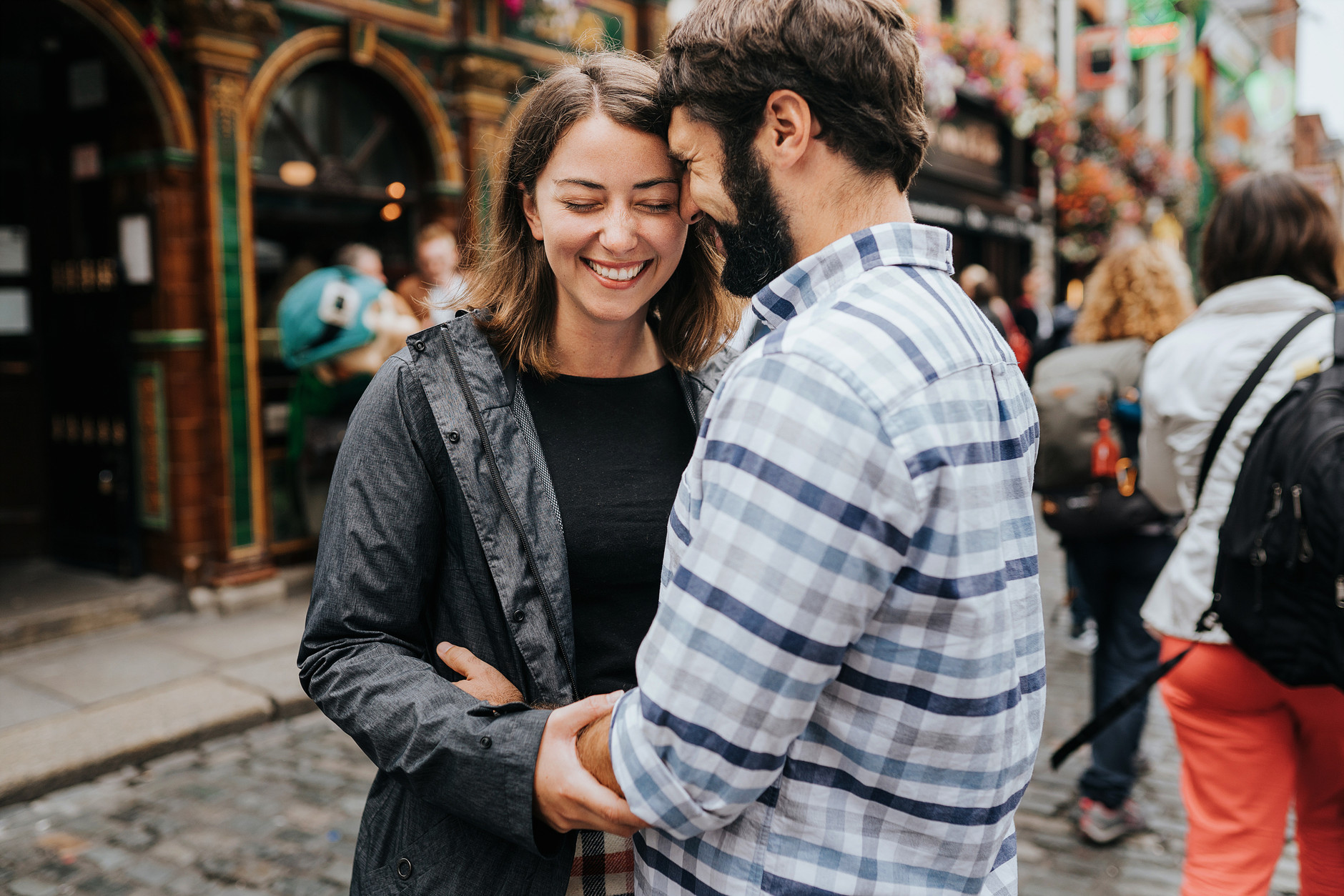 Closeup of the cute couple on vacation laughing in the street of Dublin City