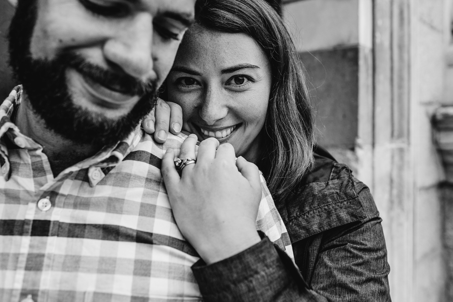 Portrait of couple with Laura looking at the camera, smiling, wedding ring