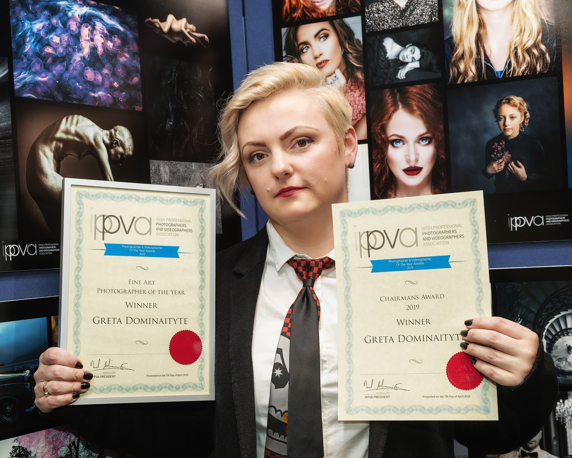 Greta holding her two certificates for Fine Art Photographer of the Year and Chairman's Award