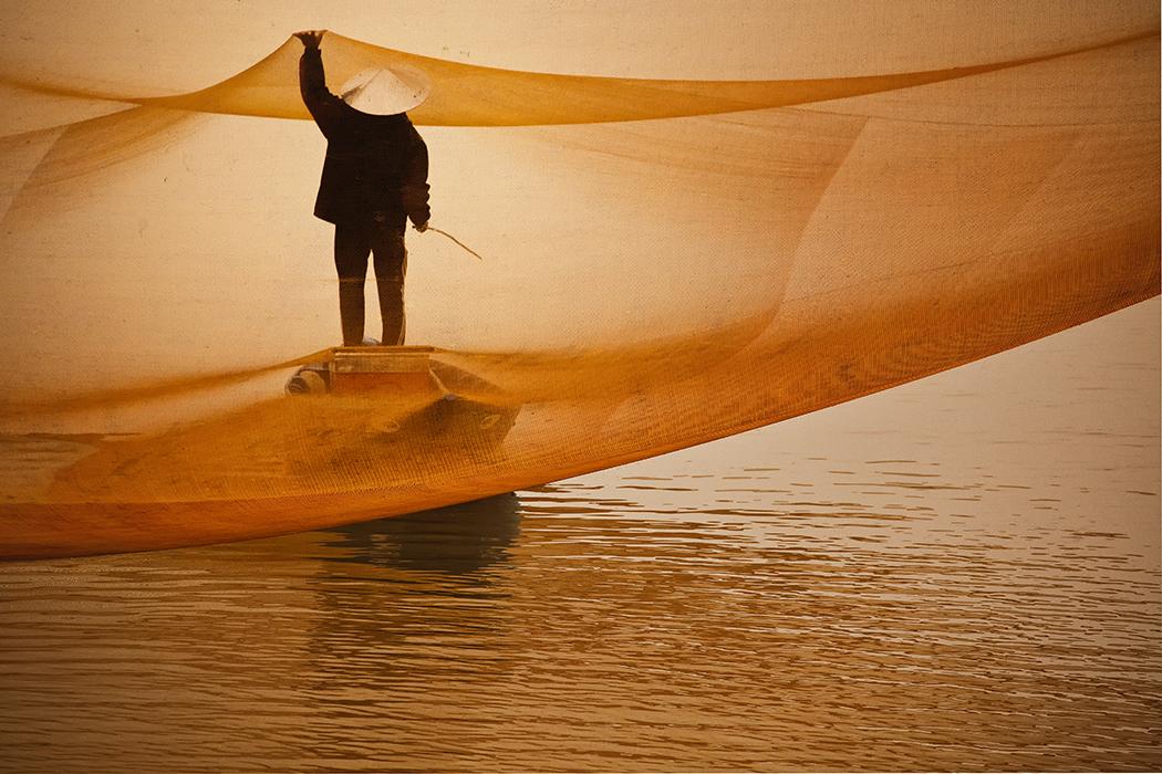 Fisherman in Net