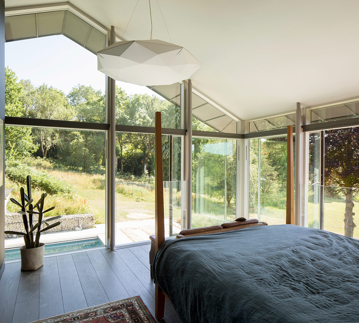 Bedroom of extension and remodelling of large 1970s house Porter Leake House