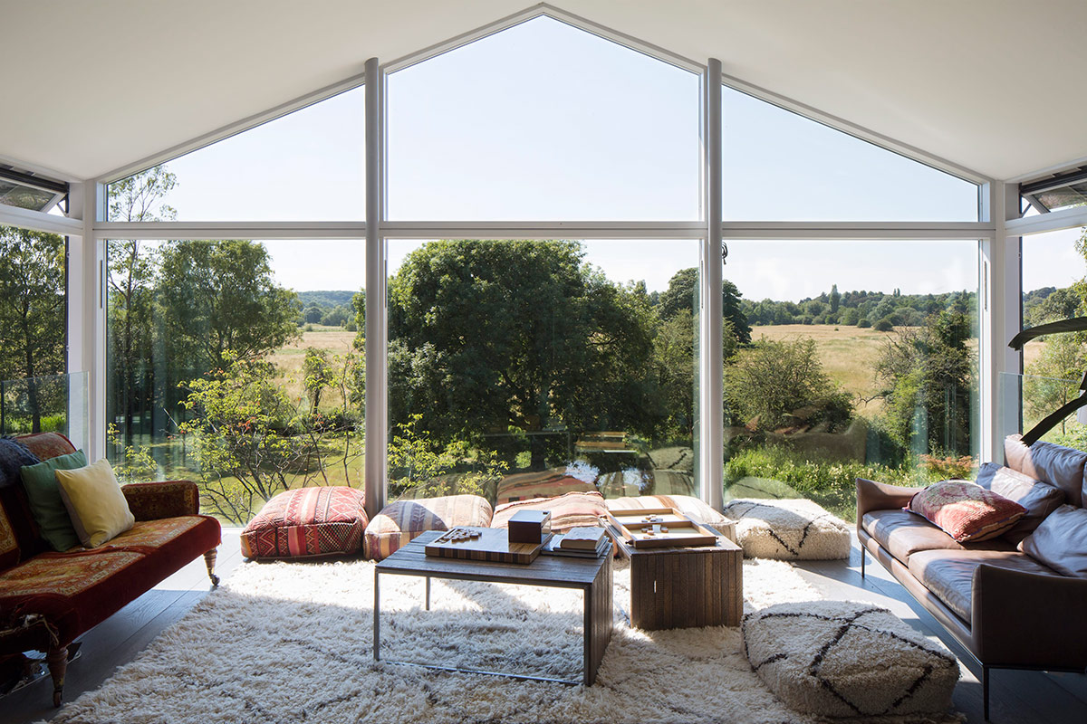 Living room of extension and remodelling of large 1970s house Porter Leake House with countryside views