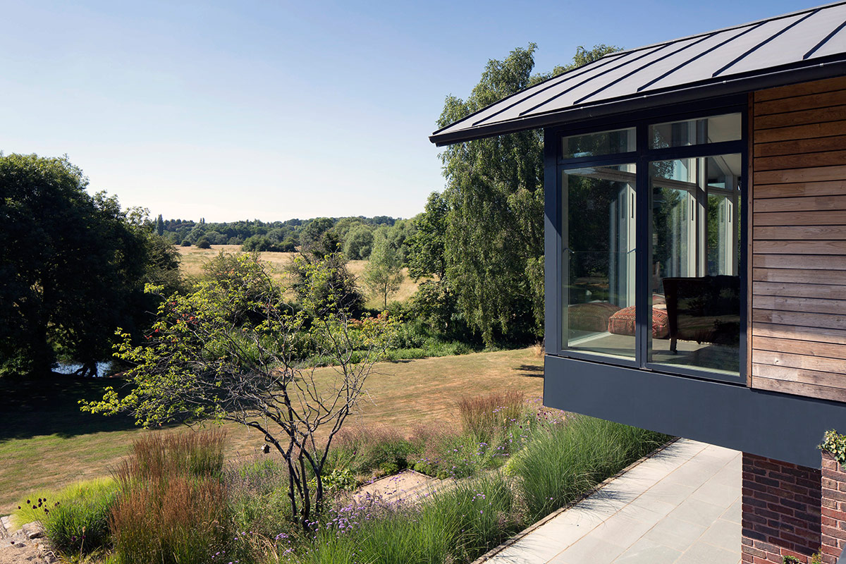 Exterior of extension and remodelling of large 1970s house Porter Leake House with countryside views