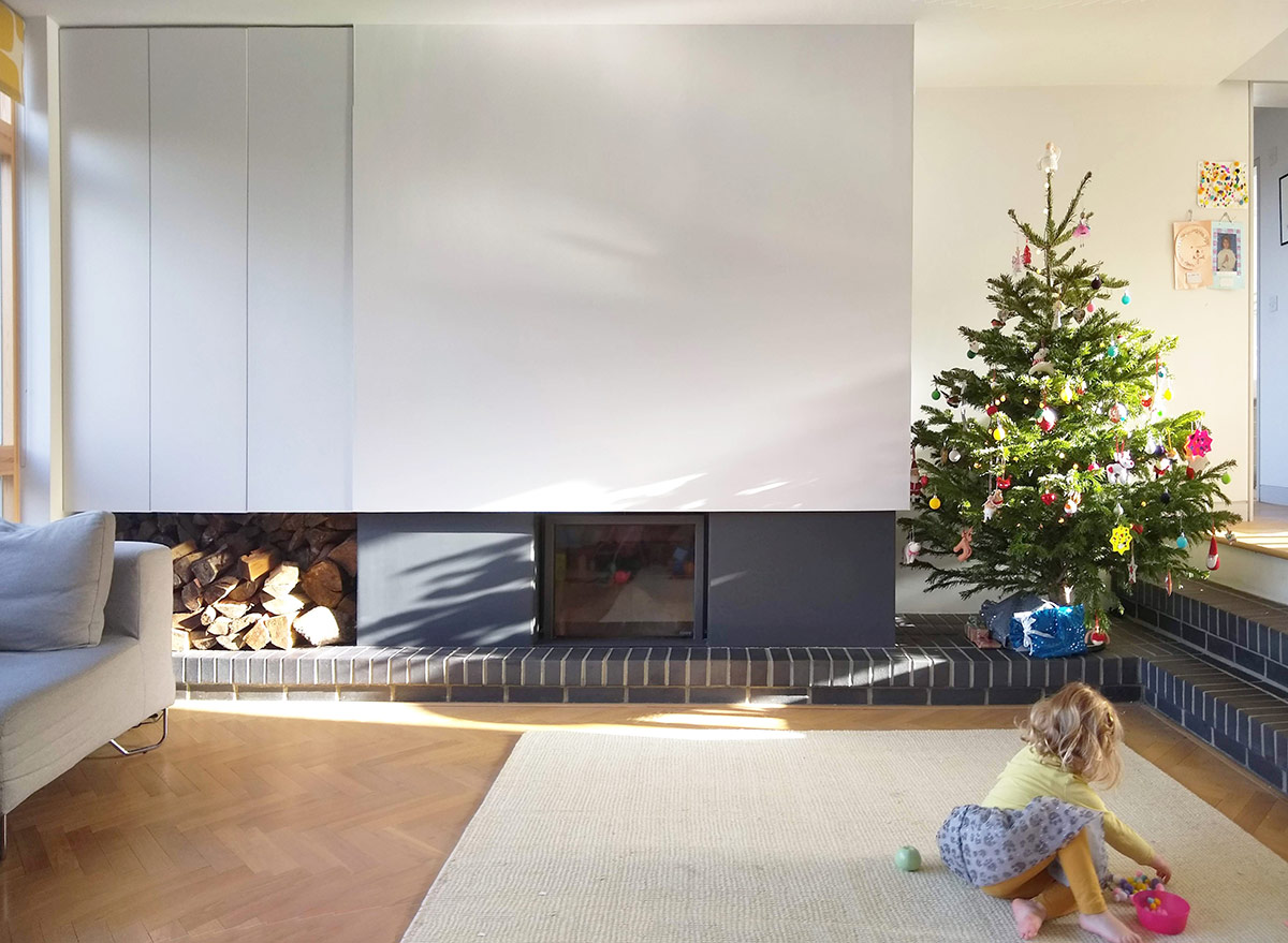 Wood-burning stove in living room of remodelling and refurbishment of a detached 1960s house in Hampshire