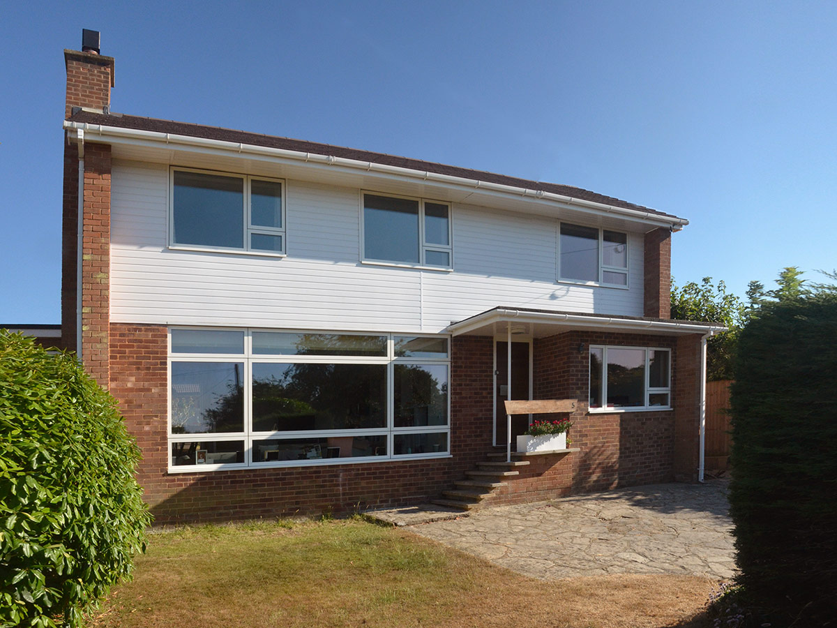 Garden at front of remodelling and refurbishment of a detached 1960s house in Lymington, Hampshire