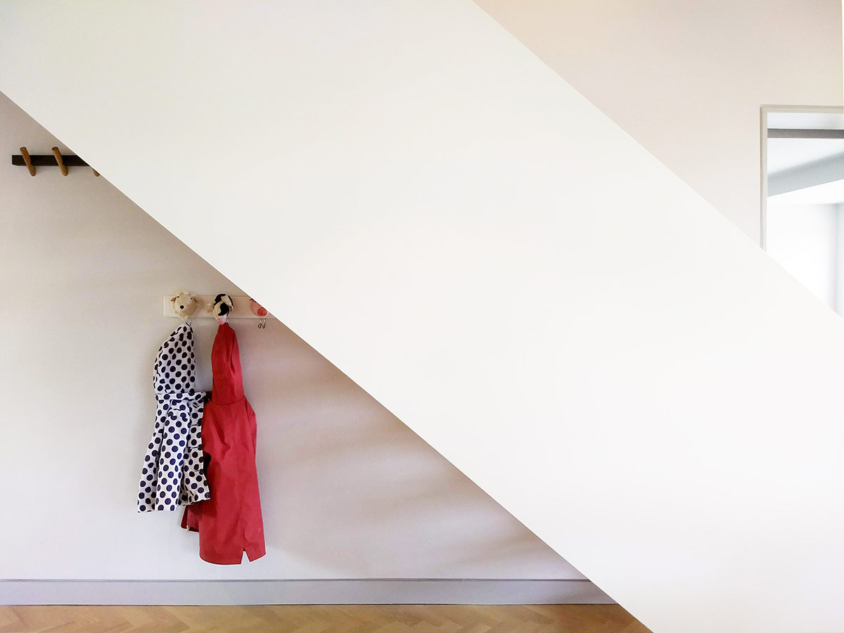 Open-riser staircase of remodelling and refurbishment of a detached 1960s house in Lymington, Hampshire