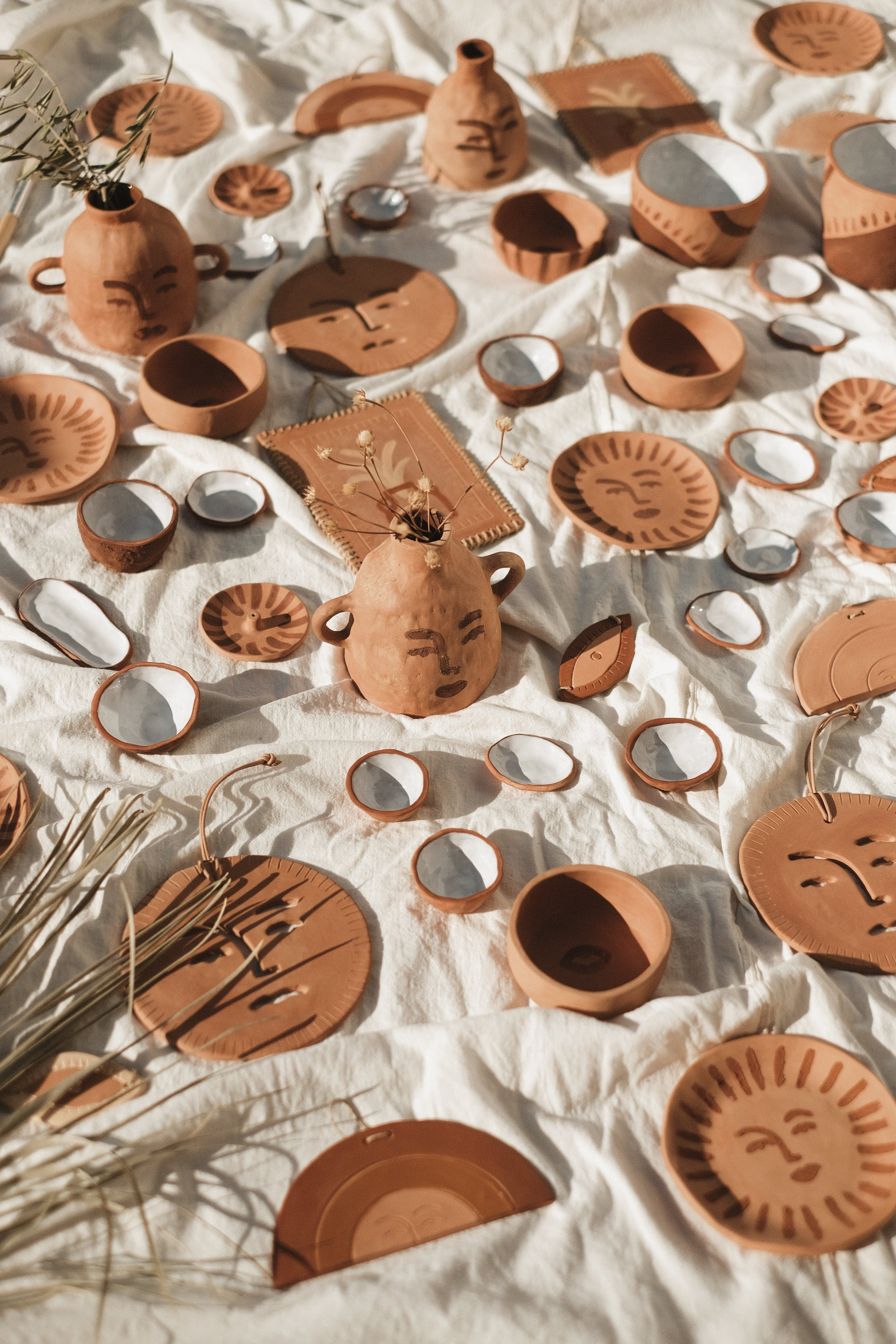 TERRACOTTA - HAND BUILT CERAMICS MADE IN OUR STUDIO WITH LOCAL CRETAN CLAY & EARTH PIGMENTSSLOWLY  RELEASING THROUGH 04-14 OCTOBER
