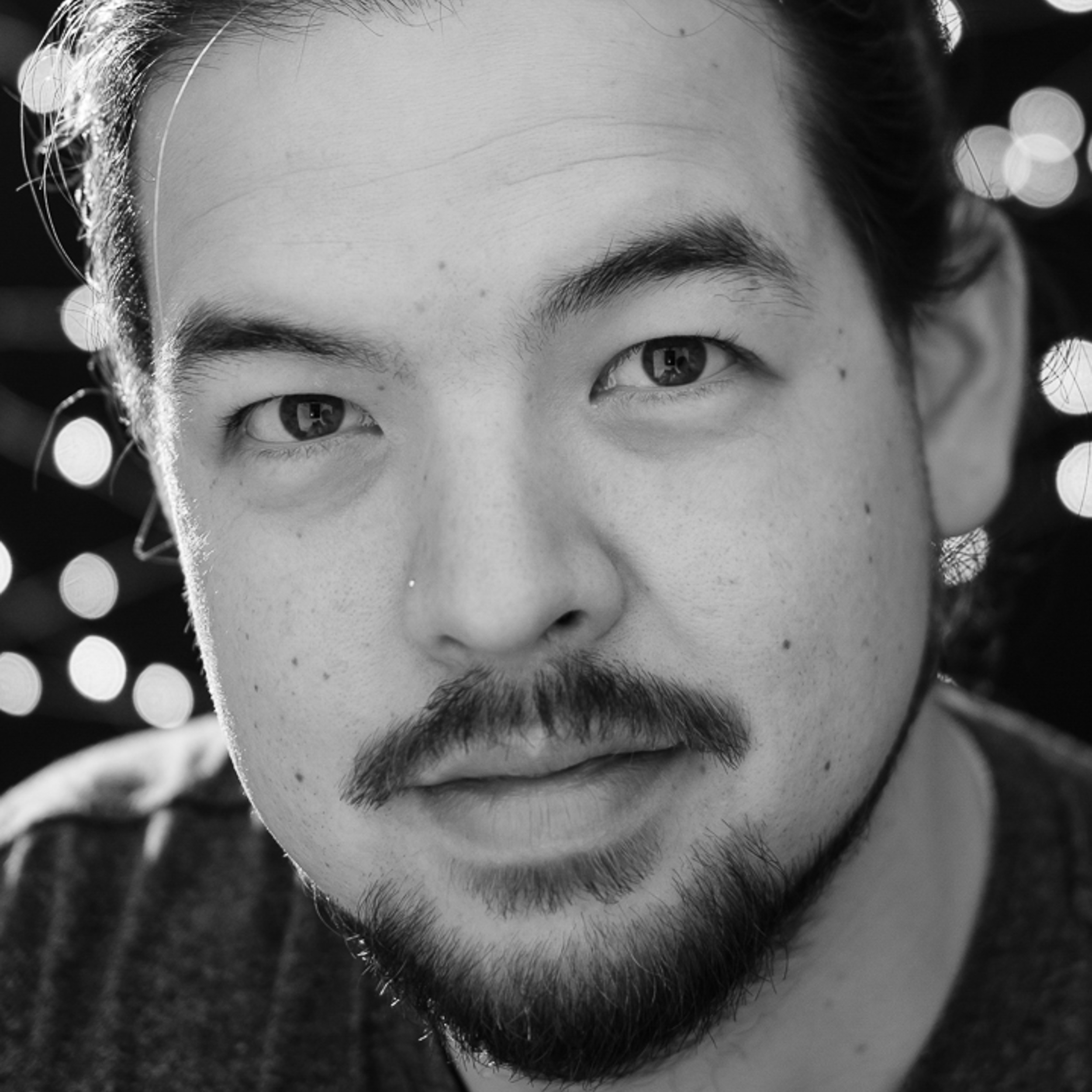 — Ryan Tonegawa - Lead Photographer, Owner, Origami Enthusiast