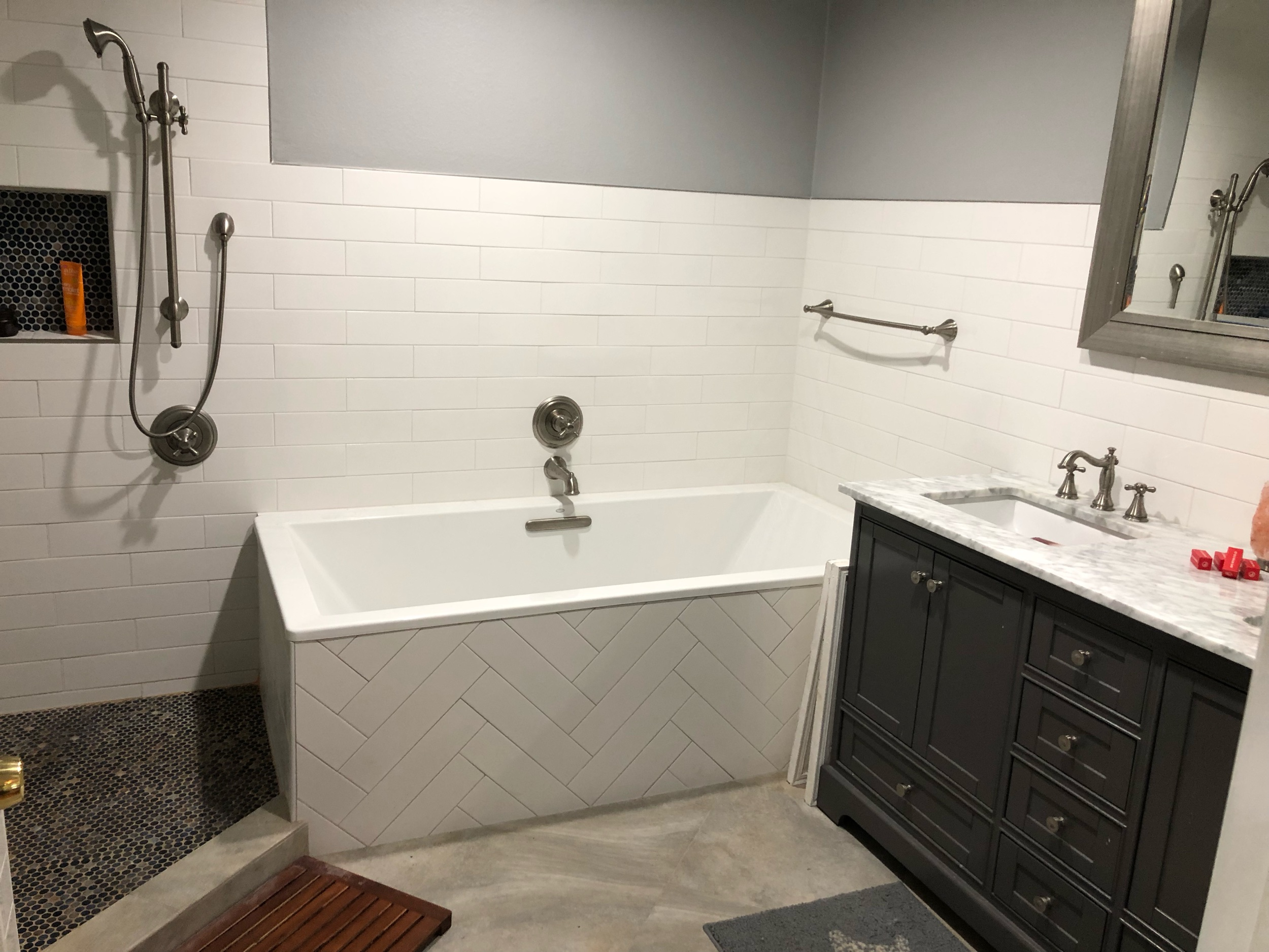 Master bathroom with ceramic tile walls.