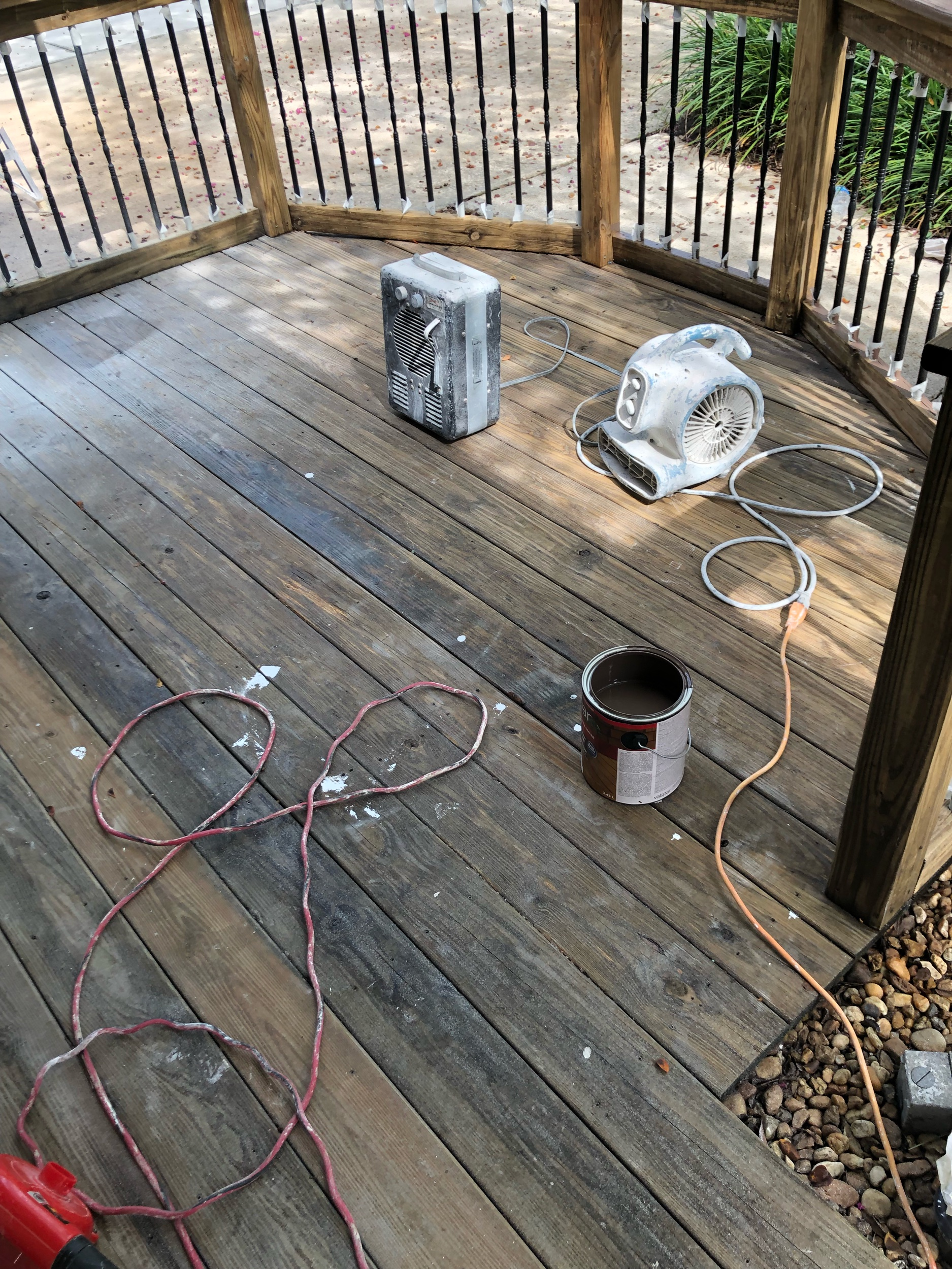 Prepping to solid stain a wooden deck.
