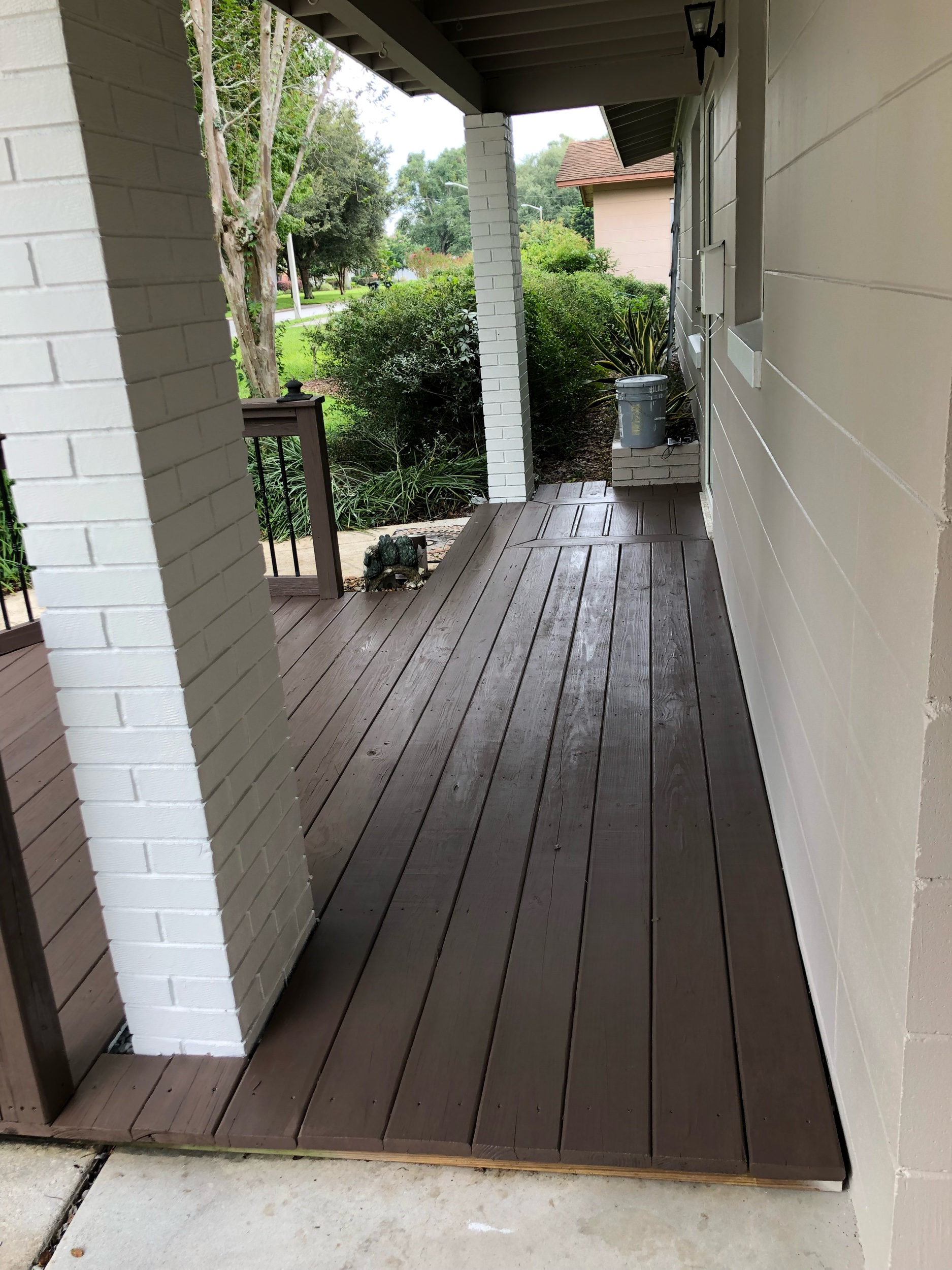 Solid stained wooden deck, one-coat coverage.