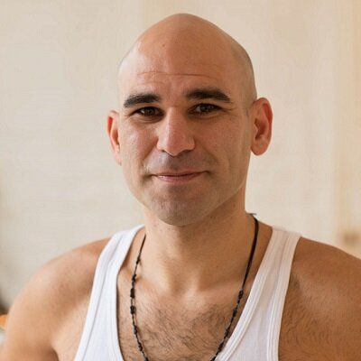 ARAM RAFFY   Like many, Aram came to yoga as therapy for serious back and knee injuries and was immediately struck by the healing and transformative qualities of the practice, both physical and mental. Especially the magical effects of the breath. The physical practice of asana (poses) and pranyama (breath extension) led to a greater awareness first of the body and then beyond, to a deeper understanding of the workings of the mind and into the practical and philosophical roots of yoga as a technology for understanding the nature of the Self and as a healing art. Aram completed his teacher training with inspirational yogi Doug Swenson and continues to regularly practice with and assist his longterm teacher Stewart Gilchrist. He has travelled and meditated extensively in search of amazing teachers to help expand his experience. The roots of his practice are based on the teachings of Krishnamacharya and the lineage passed down by him. Classes are dynamic, challenging, filled with good humour and all inclusive.