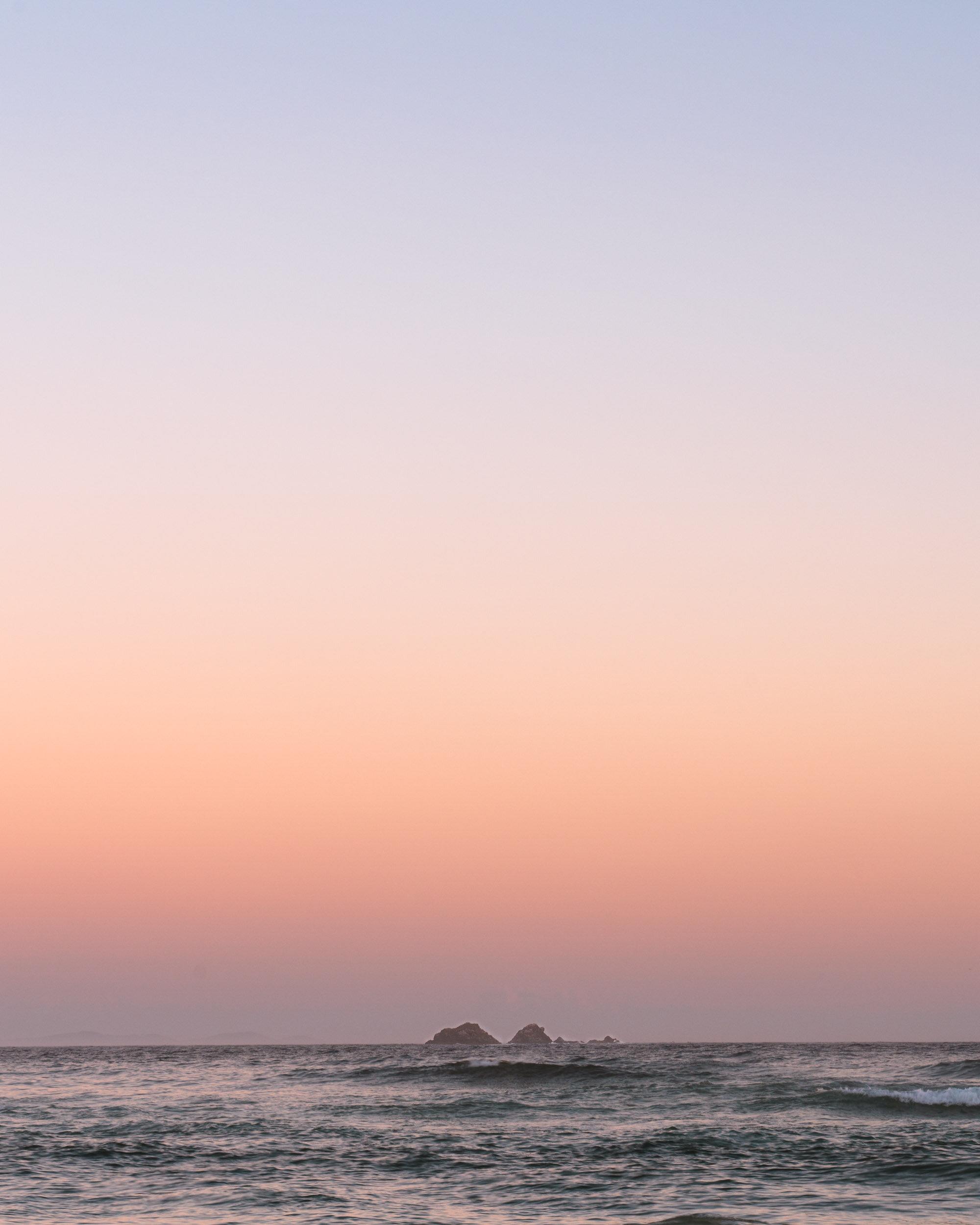 Julian Rocks in the distance from Wategos Beach at sunrise.