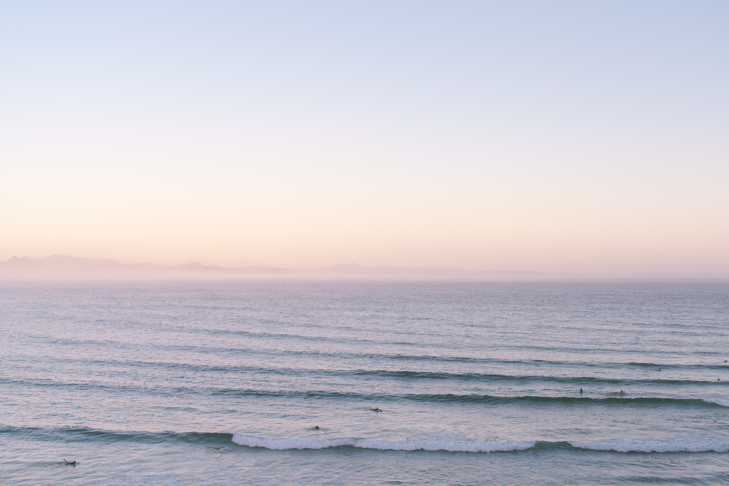 Sunrise surfers heading out, The Pass, Byron Bay