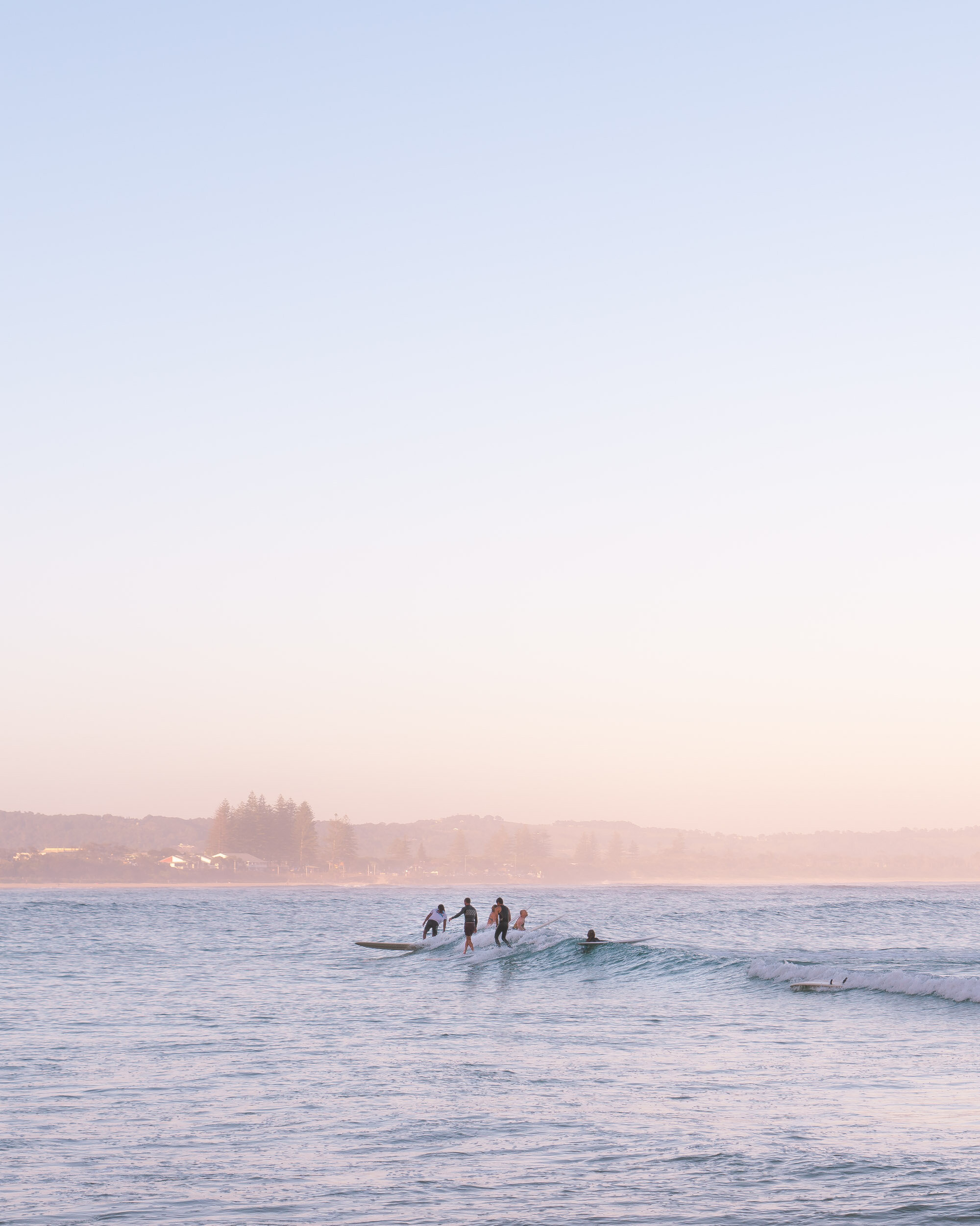Surfers sharing the breaks at The Pass, Byron Bay