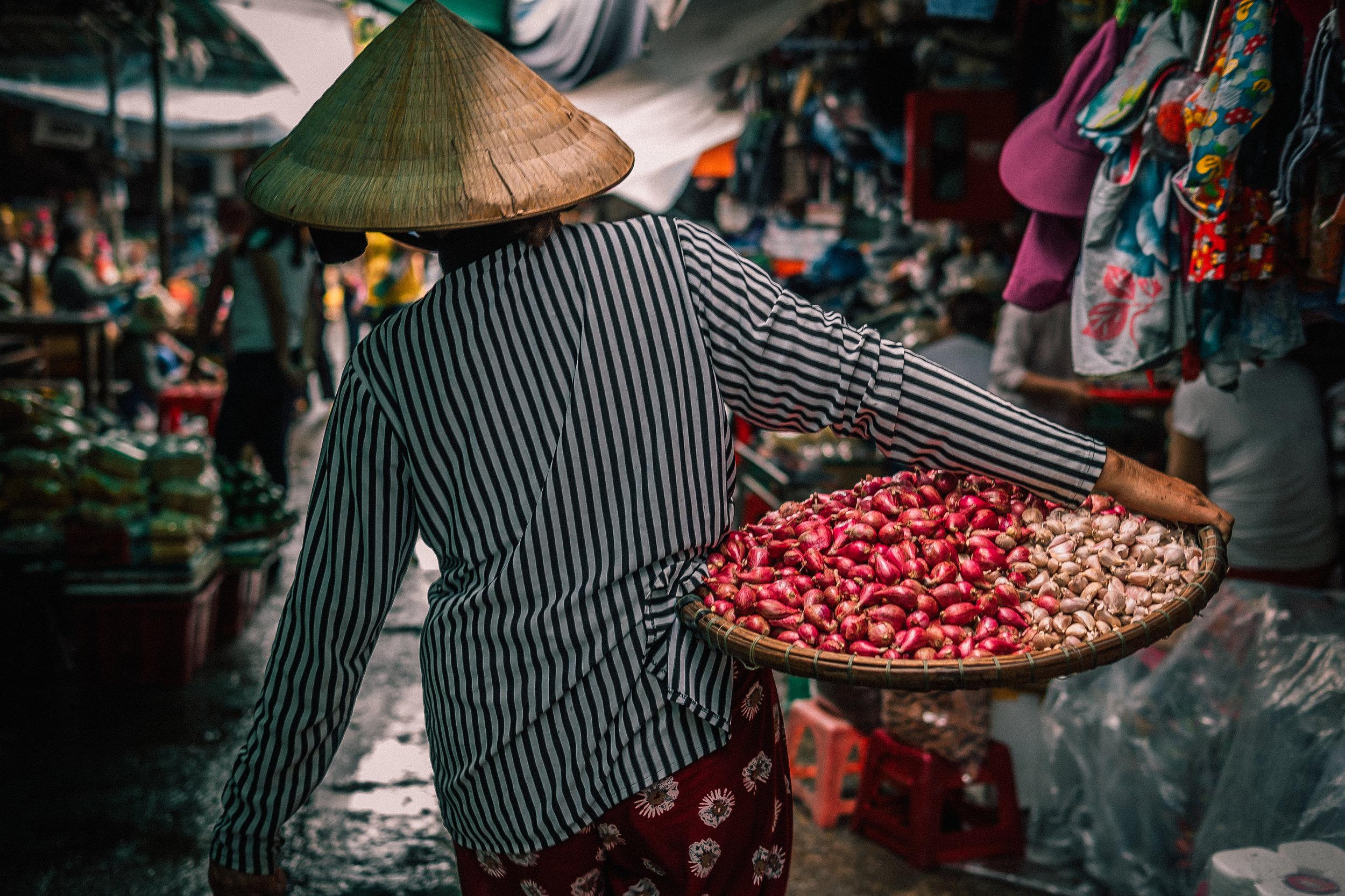 Person in Market in Vietnam