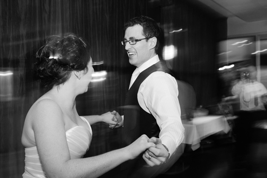 Black and white photo of couple jiving with first dance with background a blur