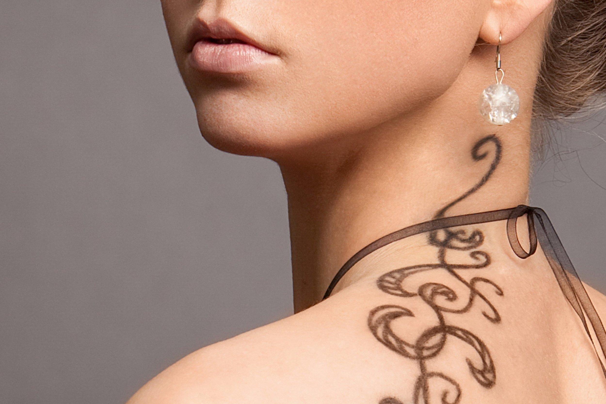 pic of tattoo girl on neck.jpg