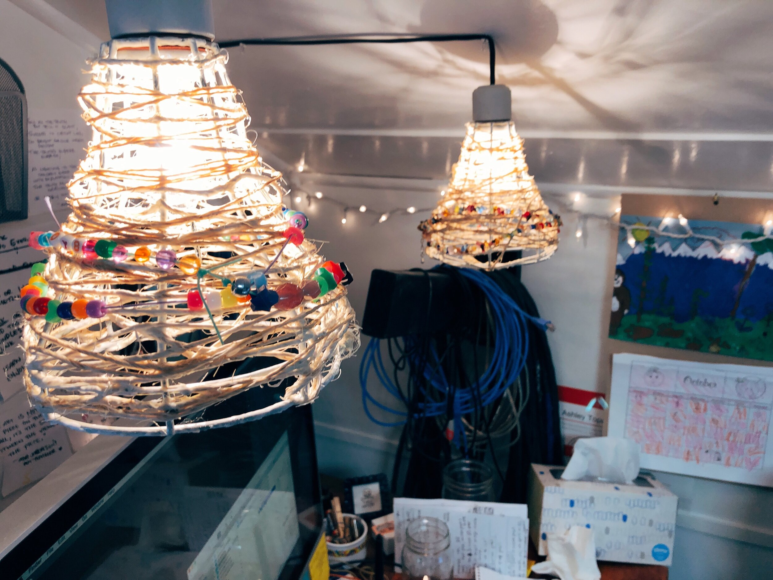 Twine-wrapped cage lights a la Pinterest.