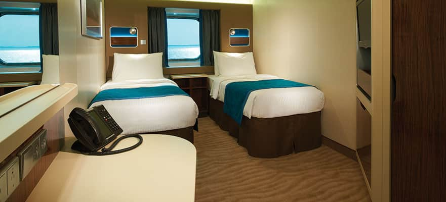 Oceanview Cabin - Located mid-ship, you will have easy access to everything. These staterooms feature a large picture window and two lower beds that convert to a queen-size bed. Total Approx. Size: 161 sq. ft.