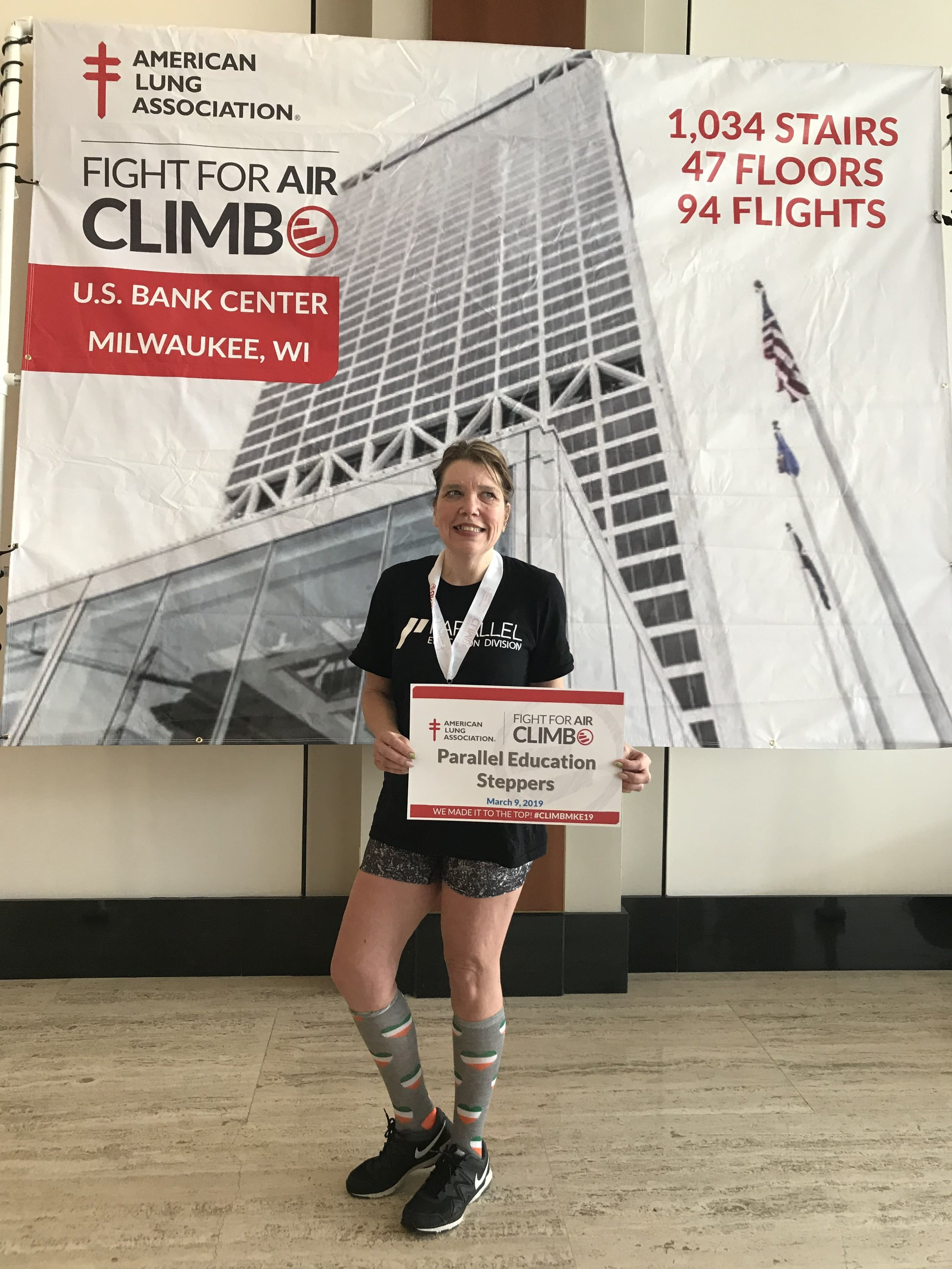 """Fight For Air Climb - We are proud to share that Kathy, a Parallel Education Division employee, participated in the American Lung Association Fight For Air Climb event! This event was held March 9, 2019 at the U.S. Bank Center in Milwaukee, WI. Kathy participated in the """"Power Hour Challenge"""" which challenged participants to climb 42 floors, multiple times, in a one hour time allotment. Kathy successfully completed 4 rounds! Parallel sponsored Kathy's team and donated to the cause.According to the American Lung Association: """"What is a Fight For Air Climb?One of the American Lung Association's signature fundraising events, Fight For Air Climbs are stair climbs held in prominent skyscrapers around the country. Climbers join friends, family, co-workers or even fly solo, climbing the stairs of the building to the top! Over the last several years, our Fight For Air Climbs have raised more than $53 million to support the mission of the American Lung Association.More than 26,000 participants from 44 Climb events across the country came together [in 2018] to raise more than $7.4 million. You can join the challenge and raise money to help provide life-saving lung health research, patient education and public policy efforts.The Fight For Air Climbs vary in the number of stairs to climb, but each event offers an opportunity for teams and individuals to challenge themselves. And every step you take moves us forward in our fight for healthy lungs and clean air.Together we can fight lung disease successfully!""""Interested? Get involved by visiting https://www.lung.org/get-involved/events/fight-for-air-climb"""