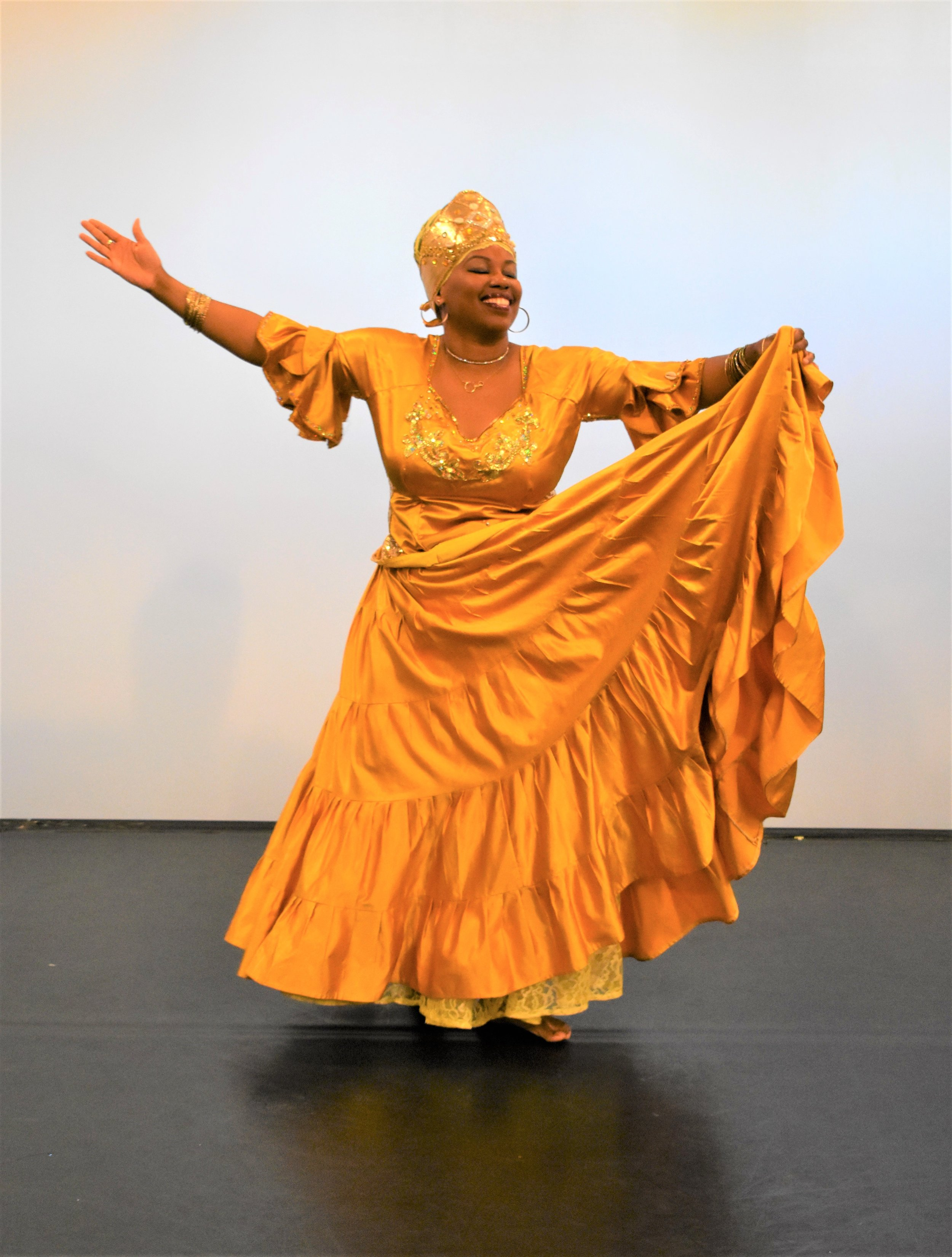 Crystal Gatling as Oshun, the goddess of sweetness and love, who succeeds in returning Ogun to his people after a long absence by tempting him with dance and honey. -