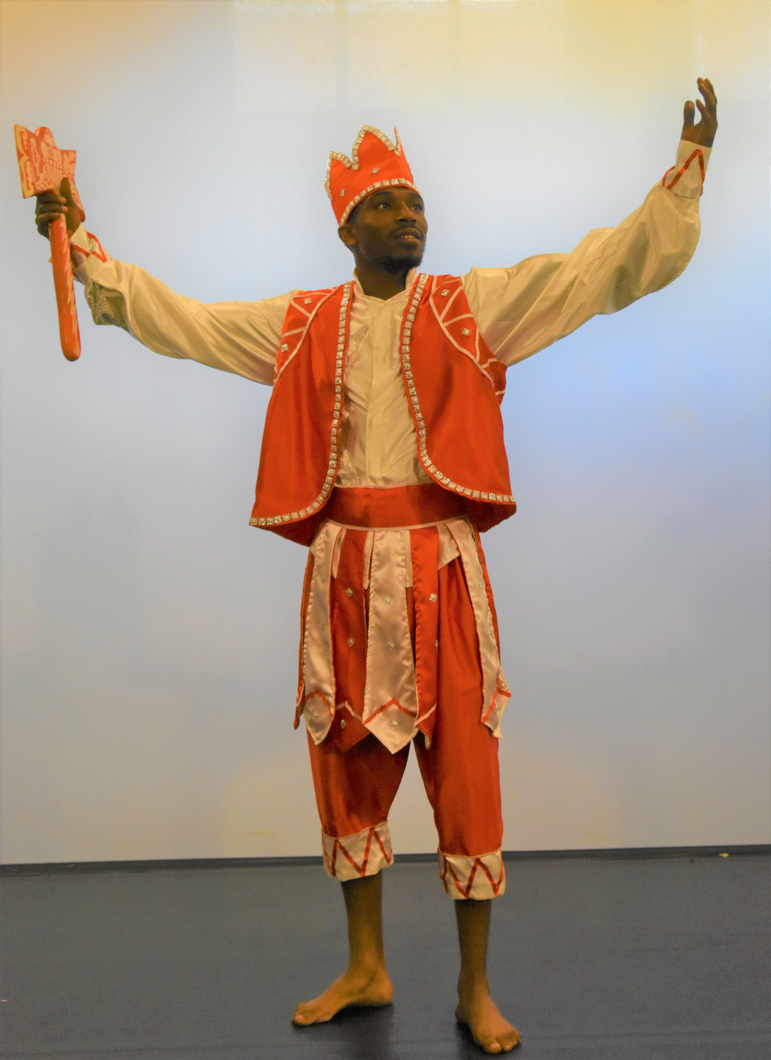 Yusuf Young as Shango, the god of thunder and lighting, who is one of the most powerful and feared orishas. -