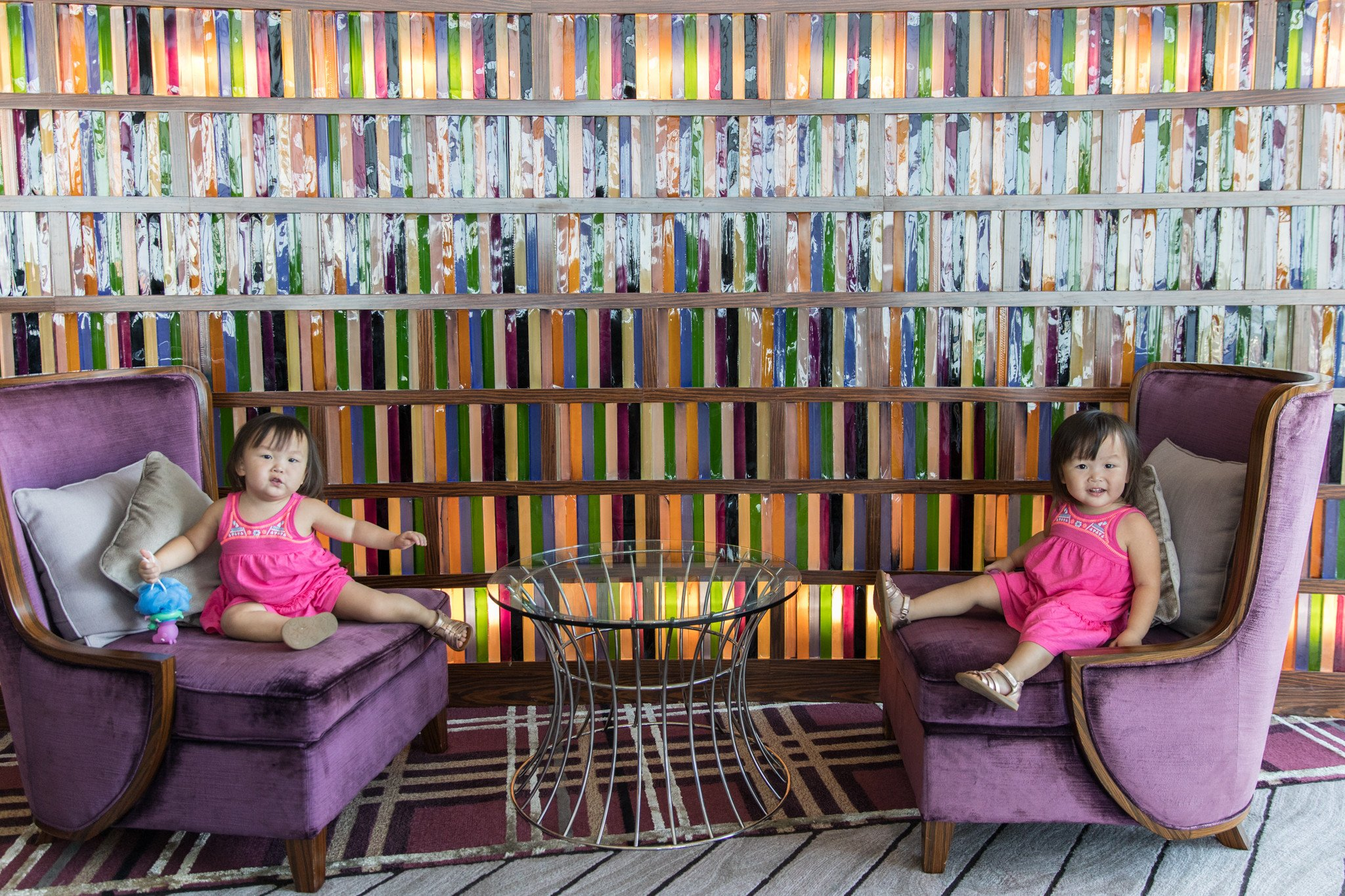Loving the 'photo-worthy' colourful tiles that looks more like a whimsical library from afar.