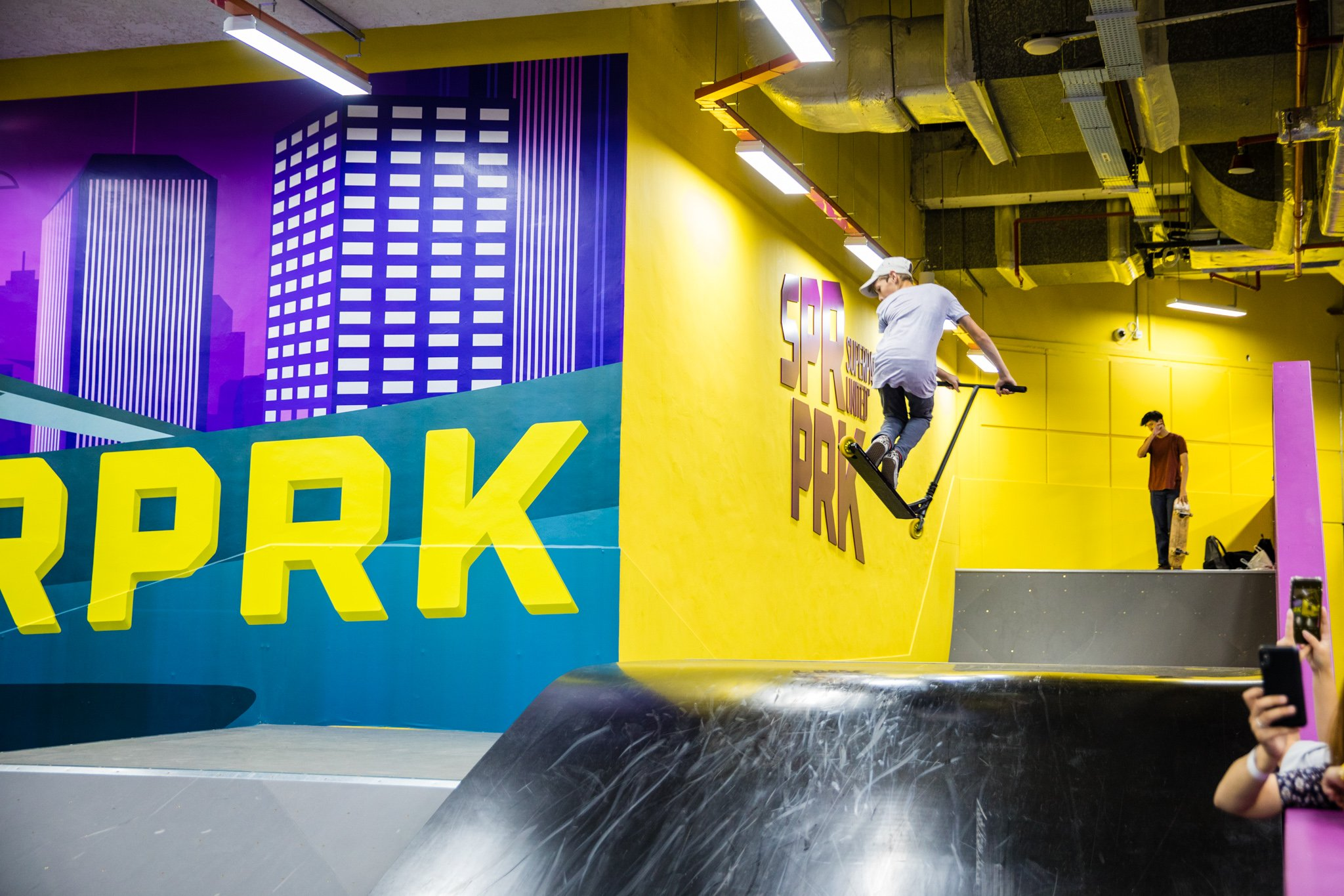 A dedicated skatepark for skaters and scooters to hone their skills.