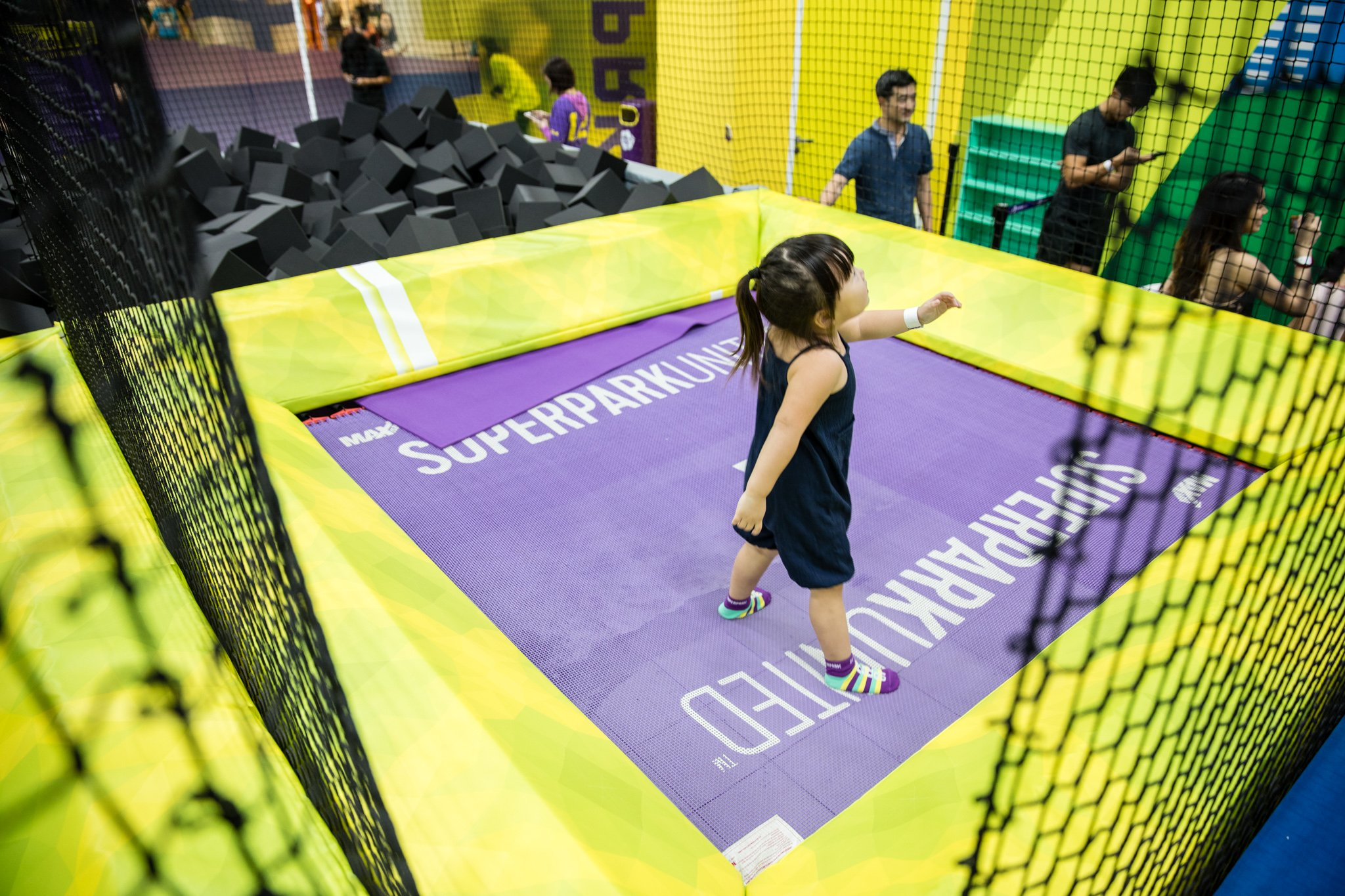 Having some freestyle fun in the adrenaline-pumped area that is complete with trampolines and climbing walls.