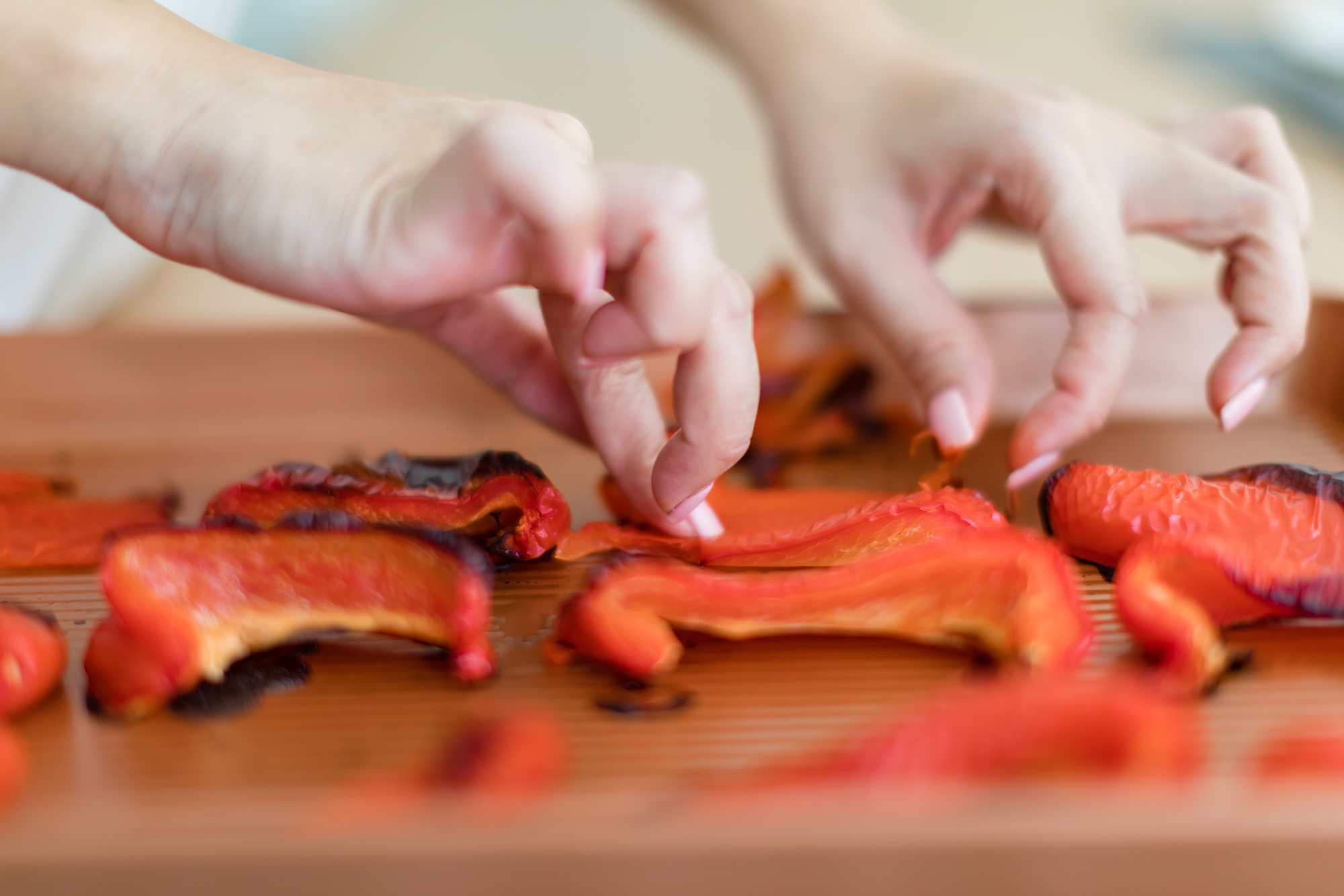 Quarter the red peppers, place them skin side up and roast them in the oven till brown to remove skin.