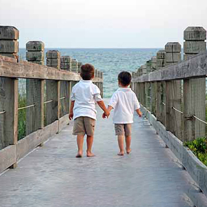 jeannie-davis-wedding-photography-children-walking-boardwalk.jpg