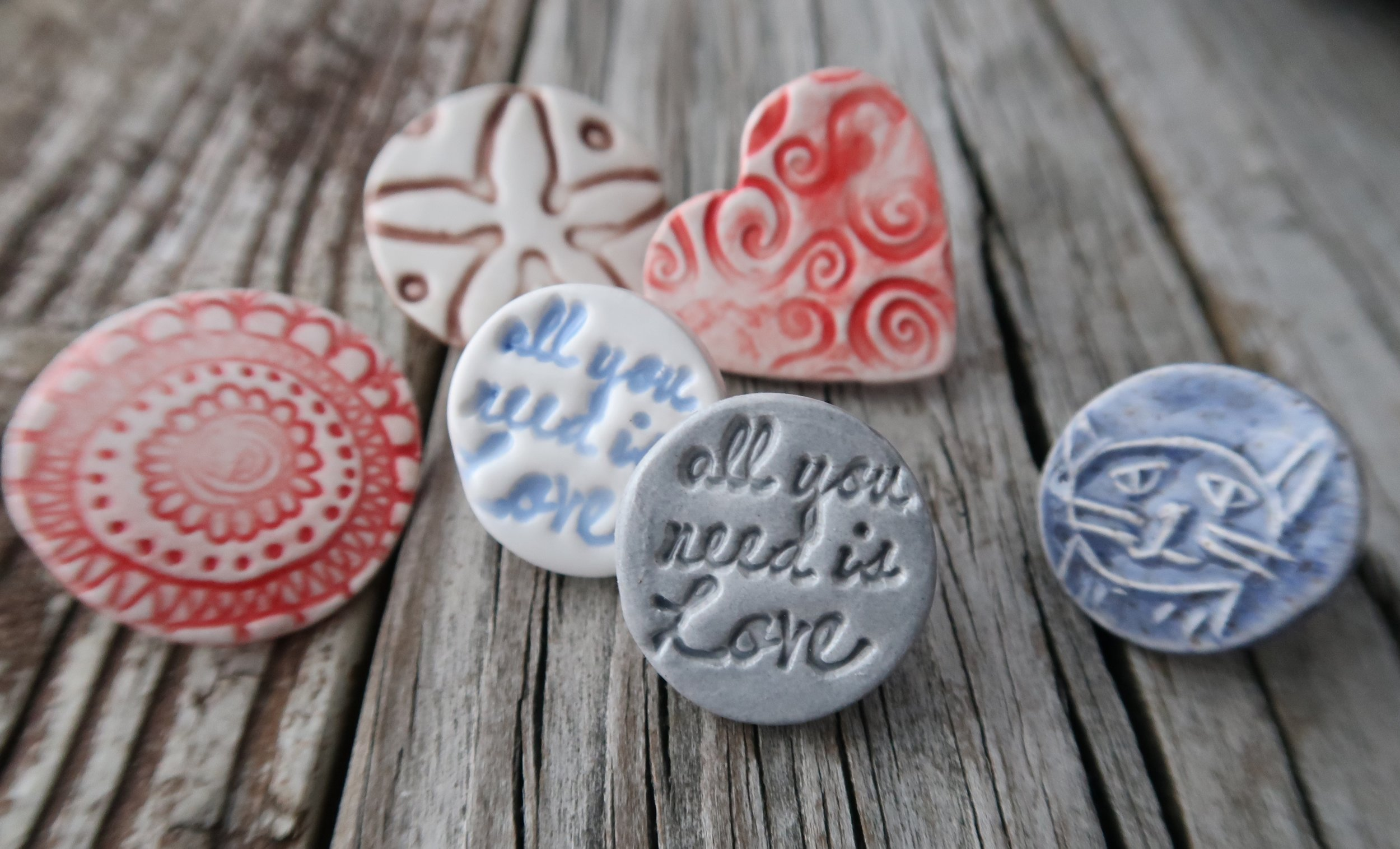 small ceramic pins for backs or backpacks as well and shirts!