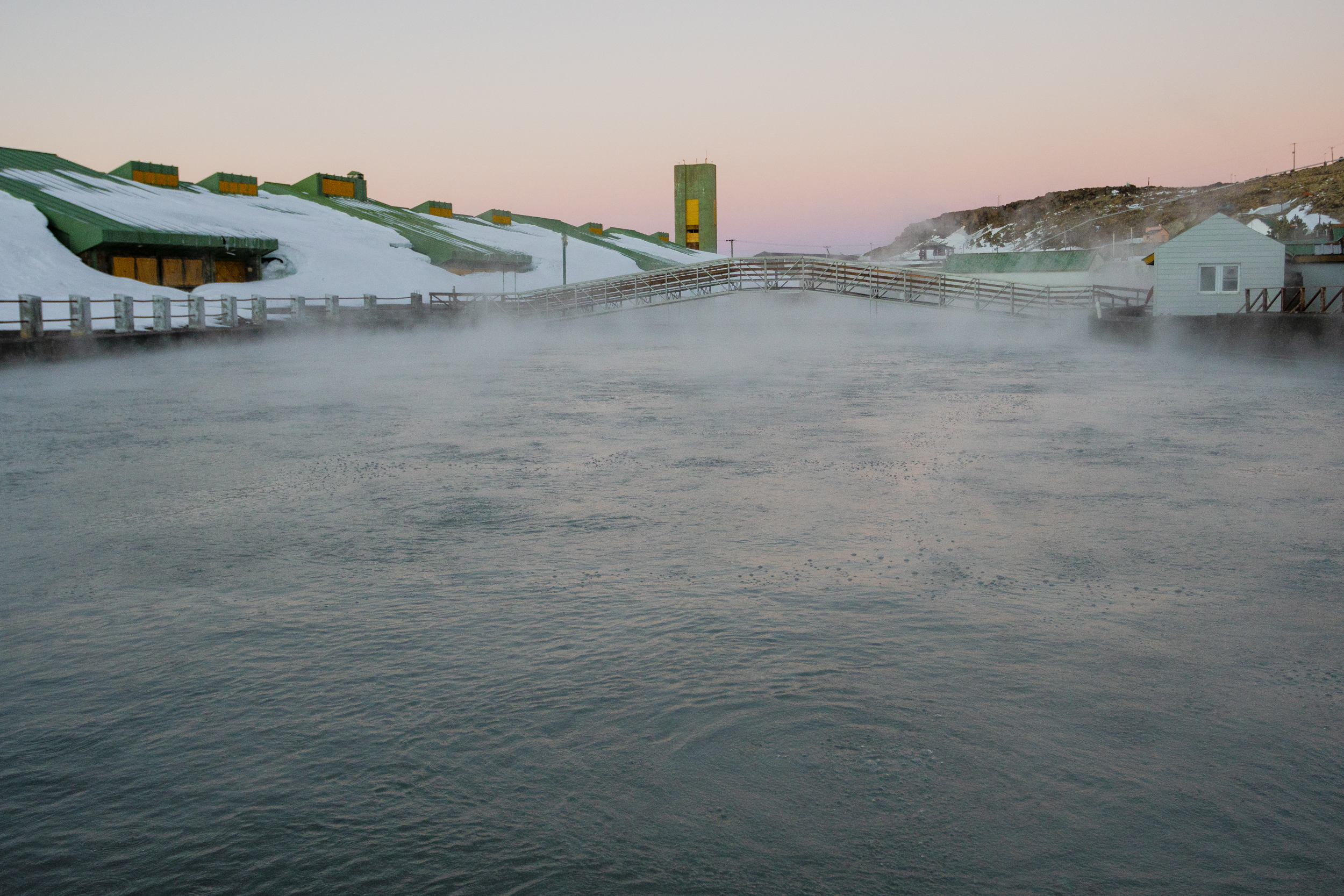 Steam rises off the largest hot spring in Copahue.