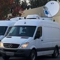 """Traditional live TV broadcast crews utilize an """"uplink truck"""" to ensure that live video signals are delivered to a receiving satellite or data center."""