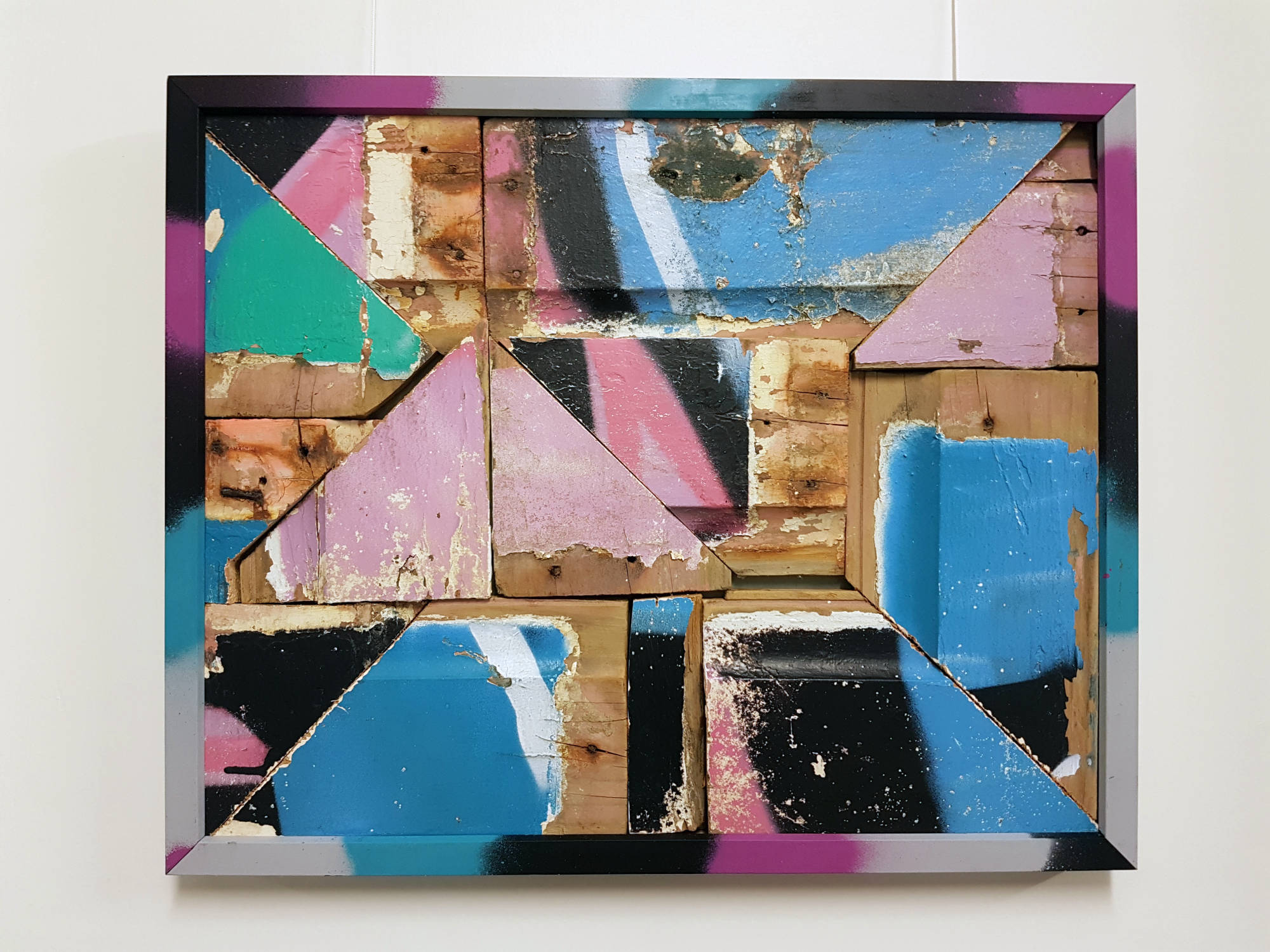 Upcycled graffiti weatherboard assemblage in frame # 1.  Dimensions: 550mm x 450mm. Price: $300
