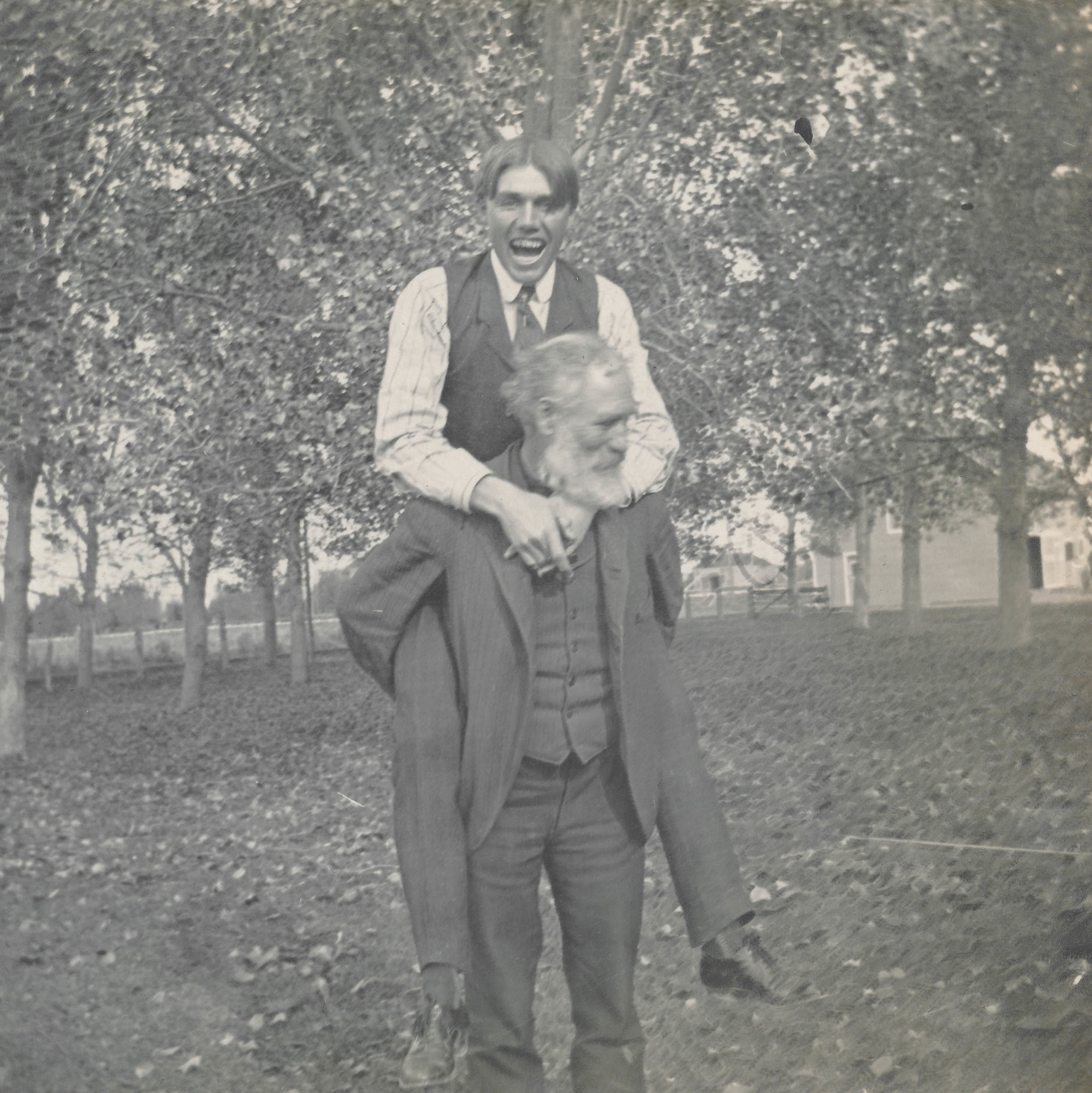 Young man rides piggyback on an old man  Undated.jpg