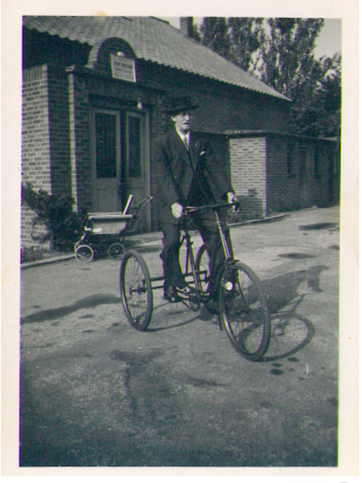 Mr Mussett, caretaker, on his tricycle (1950)