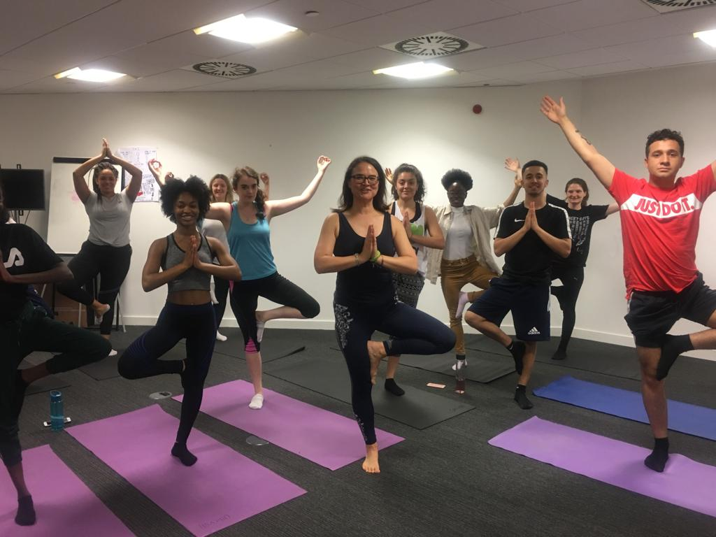 Yoga in the Boardroom at Mama Youth Project