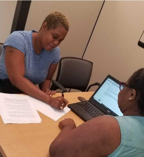 A case manager discussing the Every Ride Counts program with their client. (Credit: DC Department of Human Services)