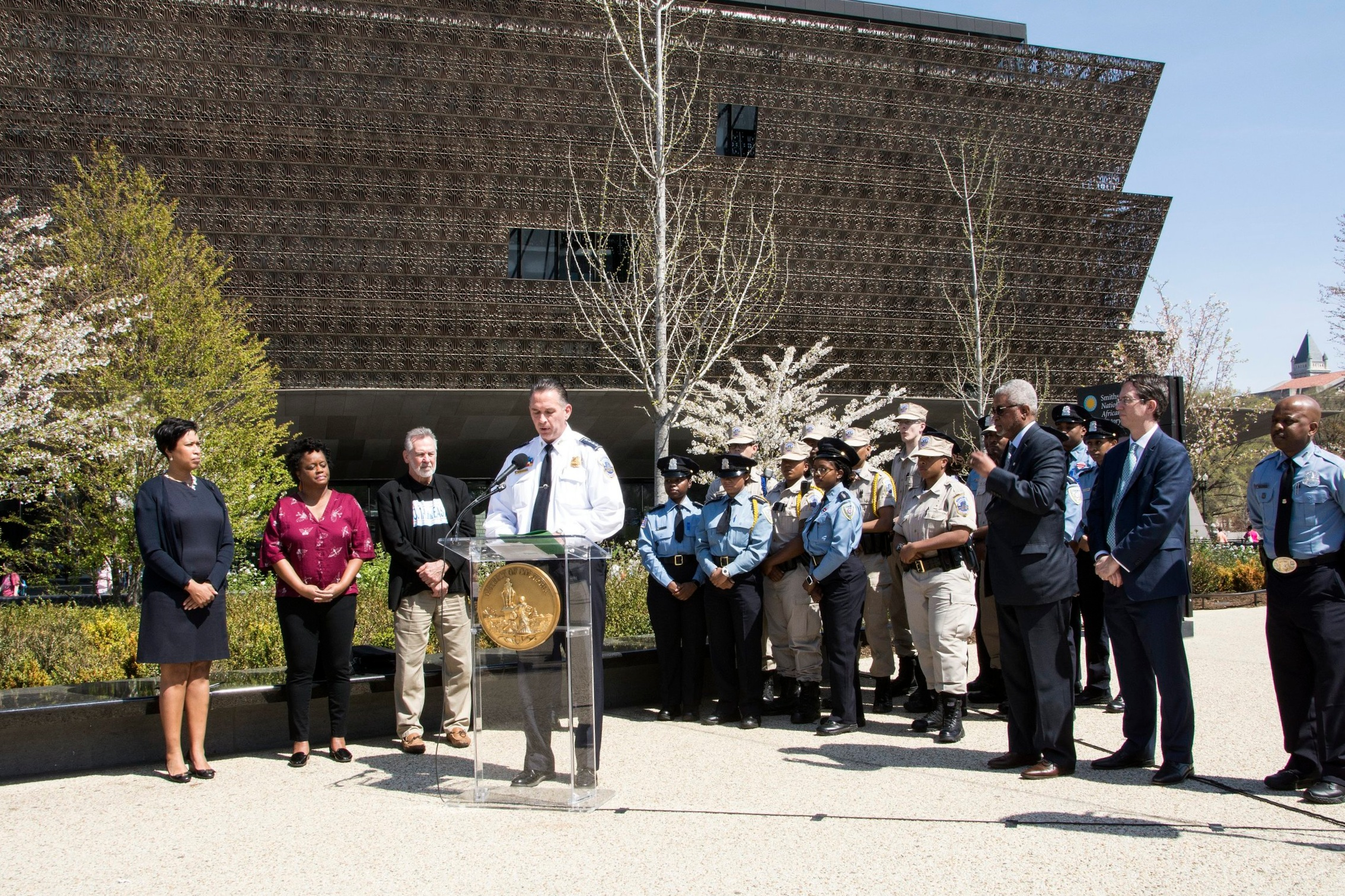 Mayor Bowser, left, and Police Chief Newsham announcing the training at the National Museum of African American History and Culture. (Credit: Elliot Williams)