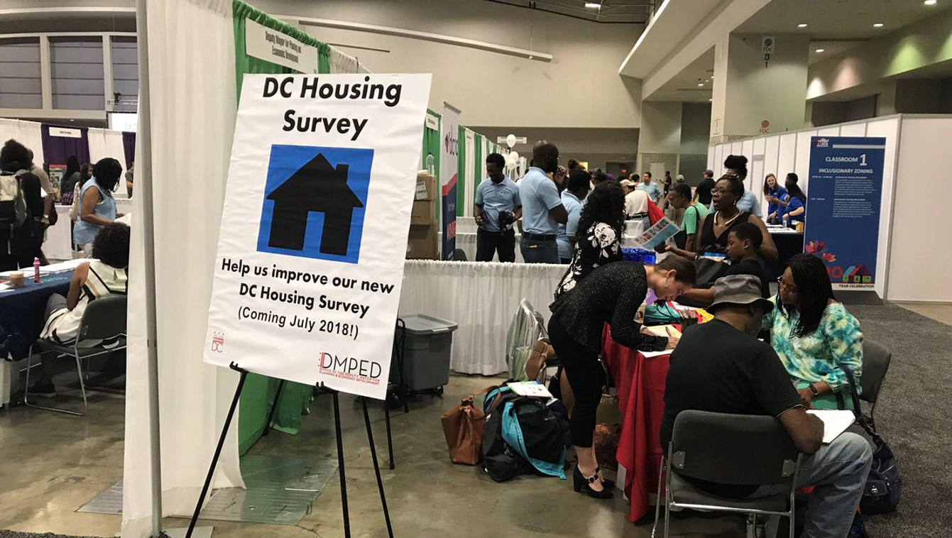 Residents test the survey prototype at the Housing Expo in June 2018. (Credit: Office of the Deputy Mayor for Planning and Economic Development)