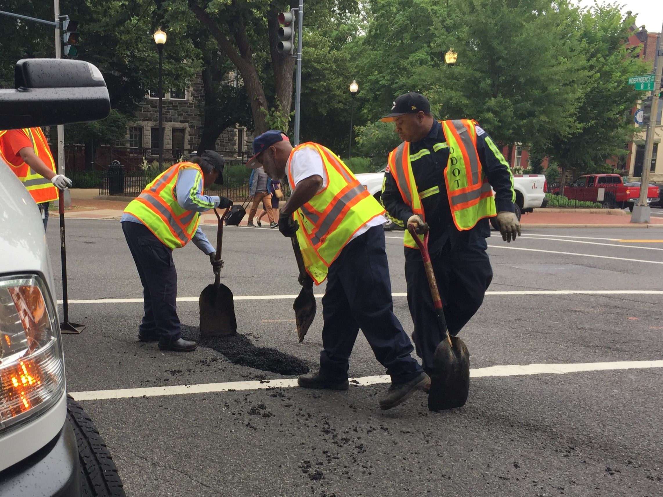 DDOT employees fill a pothole. (Credit: The Lab @ DC)