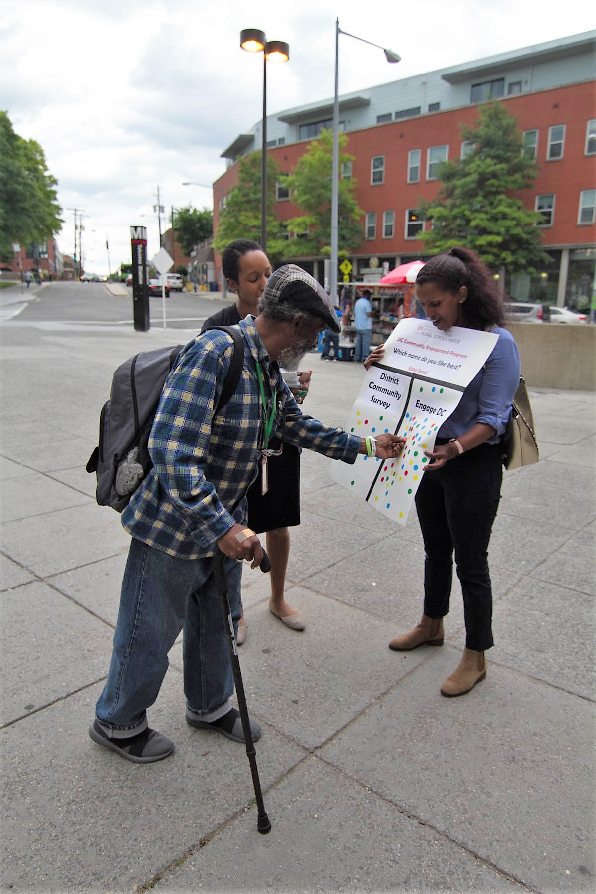 Lab team members outside a Metro station gathering resident feedback on what to name the survey platform (Credit: The Lab @ DC)