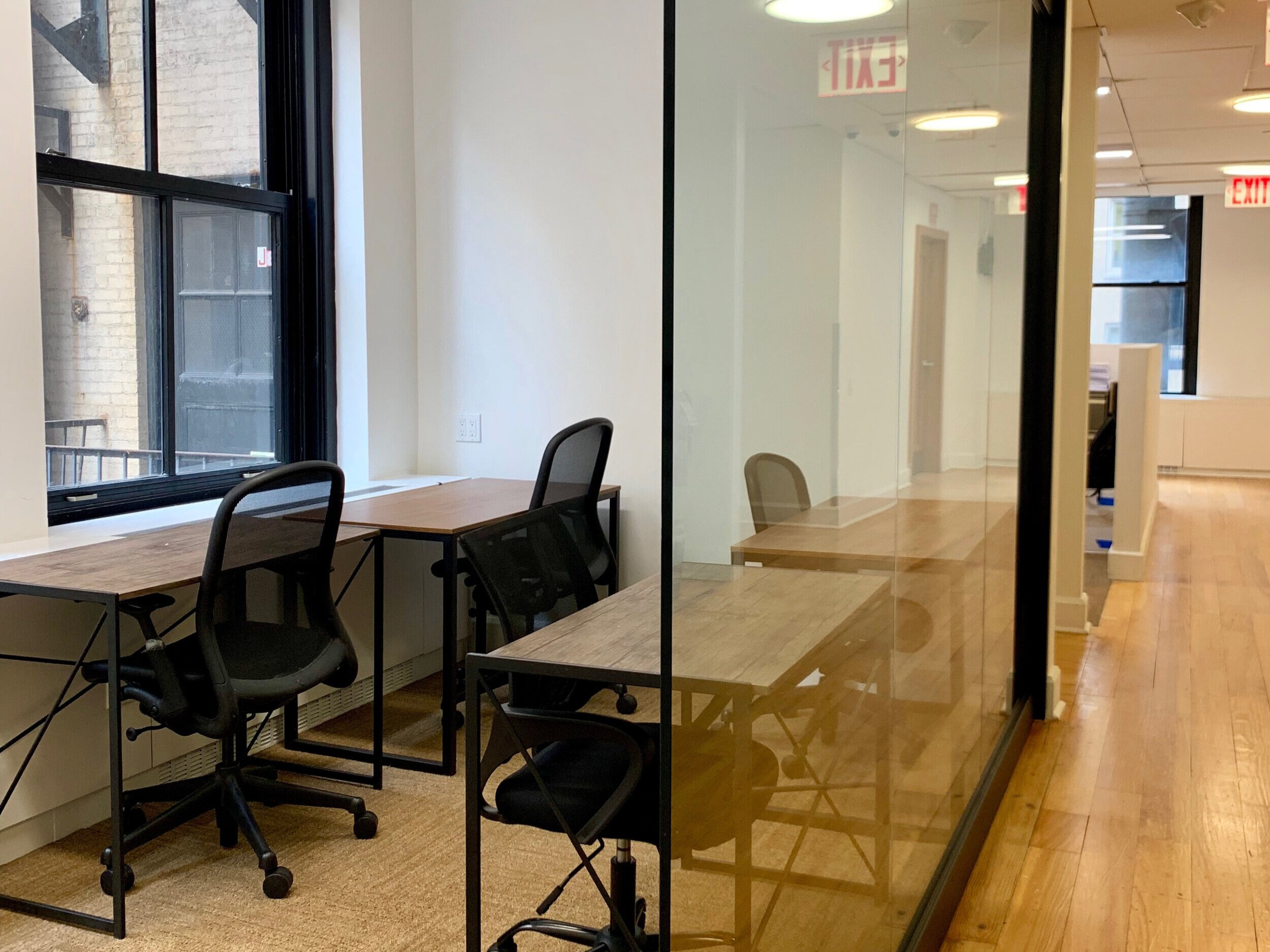 4 Person Office - A quiet office perfect for a company that needs natural light to boost productivity.